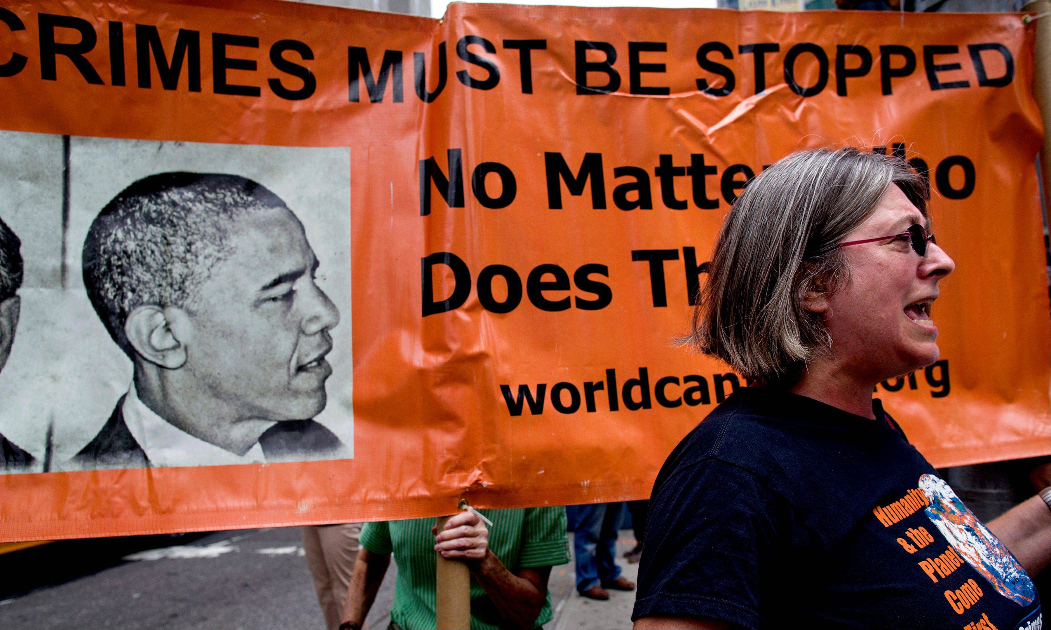 "Debra Sweet, with ""World Can't Wait,"" calls out to other opponents of U.S. military action in Syria at New York's Times Square on Saturday.Protesters around the world took to the streets to protest for and against a possible U.S.-led attack on Syria as President Barack Obama announced he would seek congressional approval for such a move."