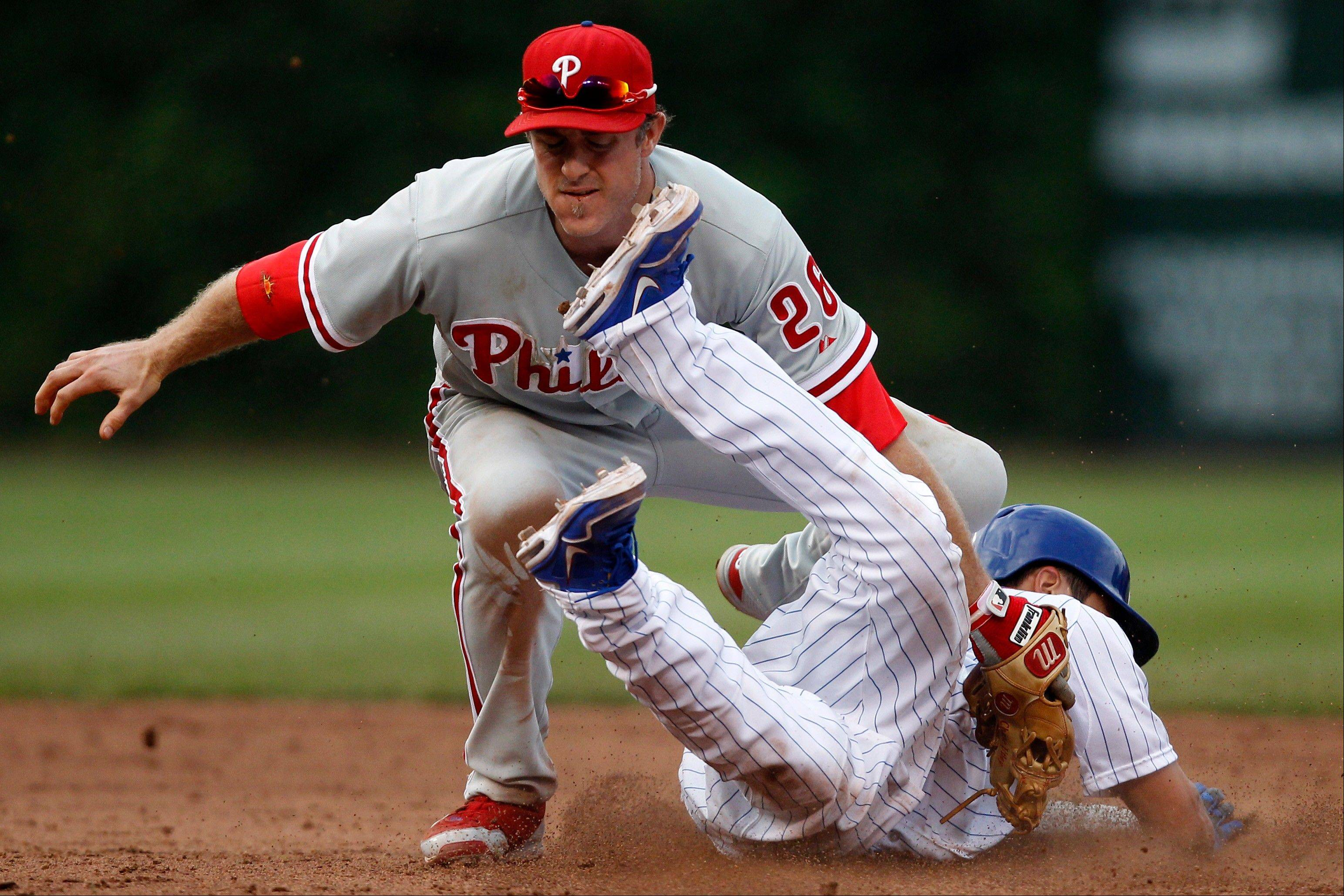 Darwin Barney safely steals second base under Philadelphia Phillies second baseman Chase Utley during the sixth inning.