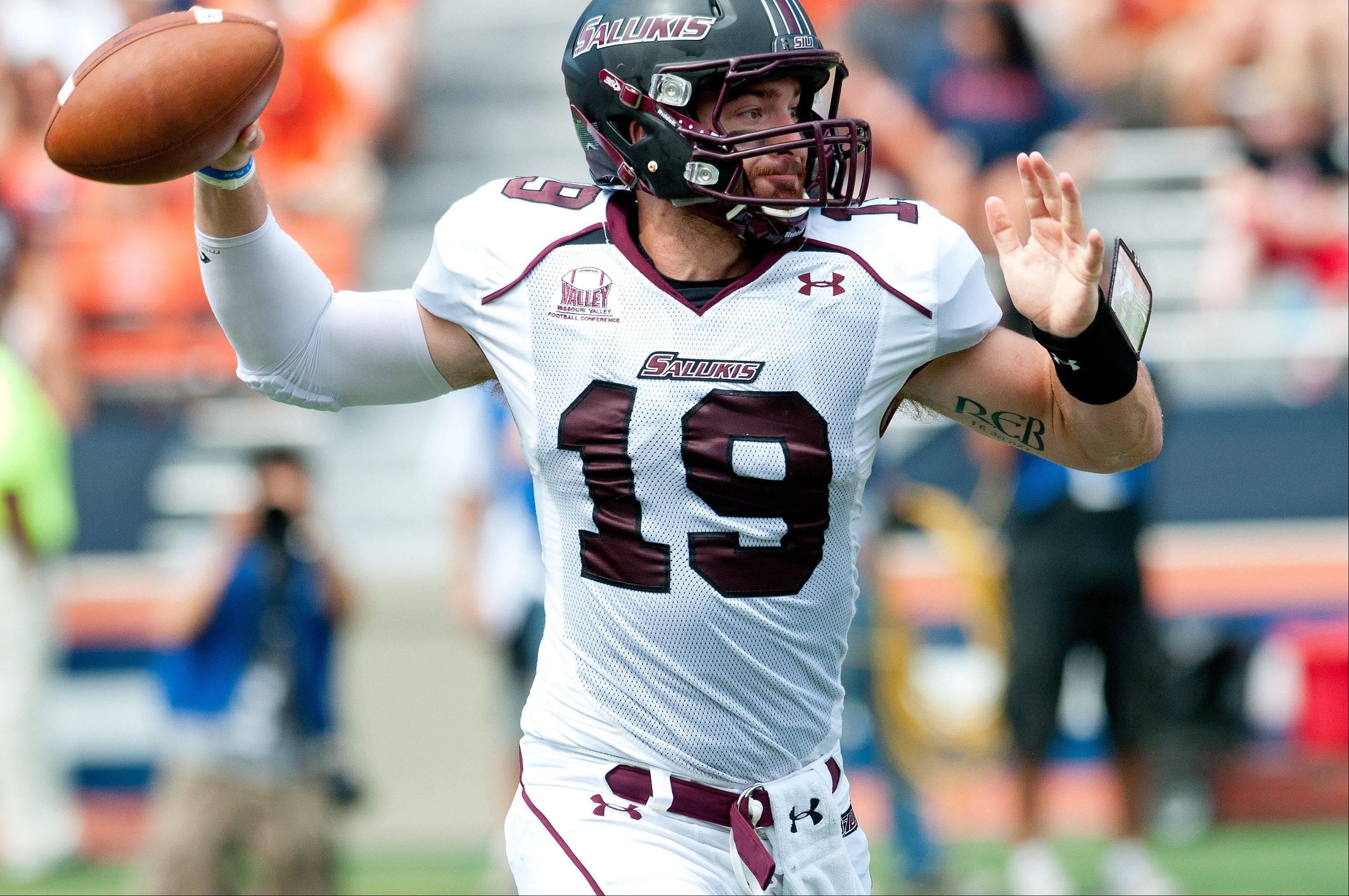 Southern Illinois quarterback Kory Faulkner (19) throws a pass against Illinois during the first half of an NCAA college football game at Memorial Stadium in Champaign.