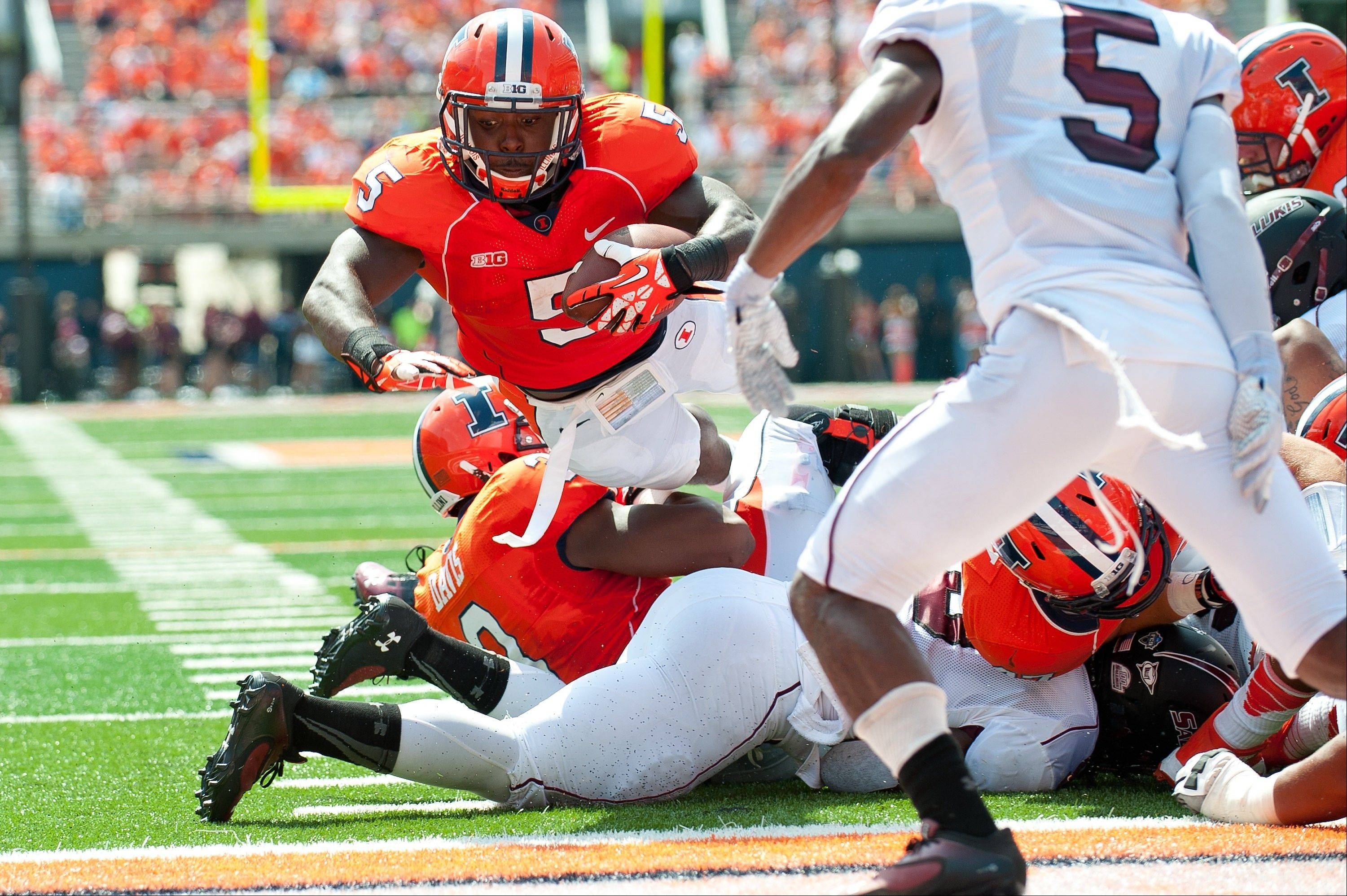 Illinois running back Donovonn Young (5) dives over the goal line for a touchdown during the second quarter.