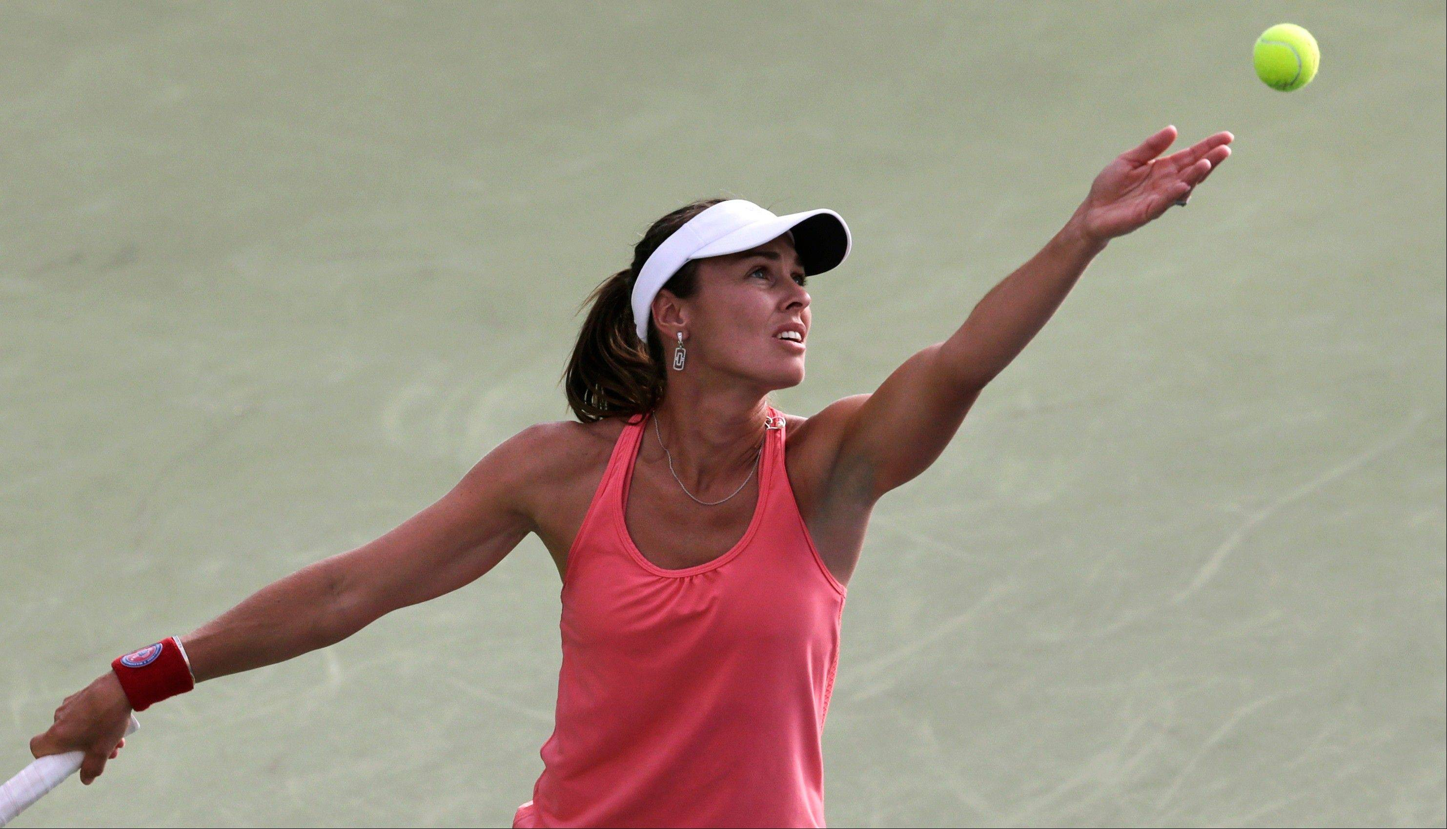 Martina Hingis serves during her doubles match Friday at the U.S. Open tennis tournament in New York.
