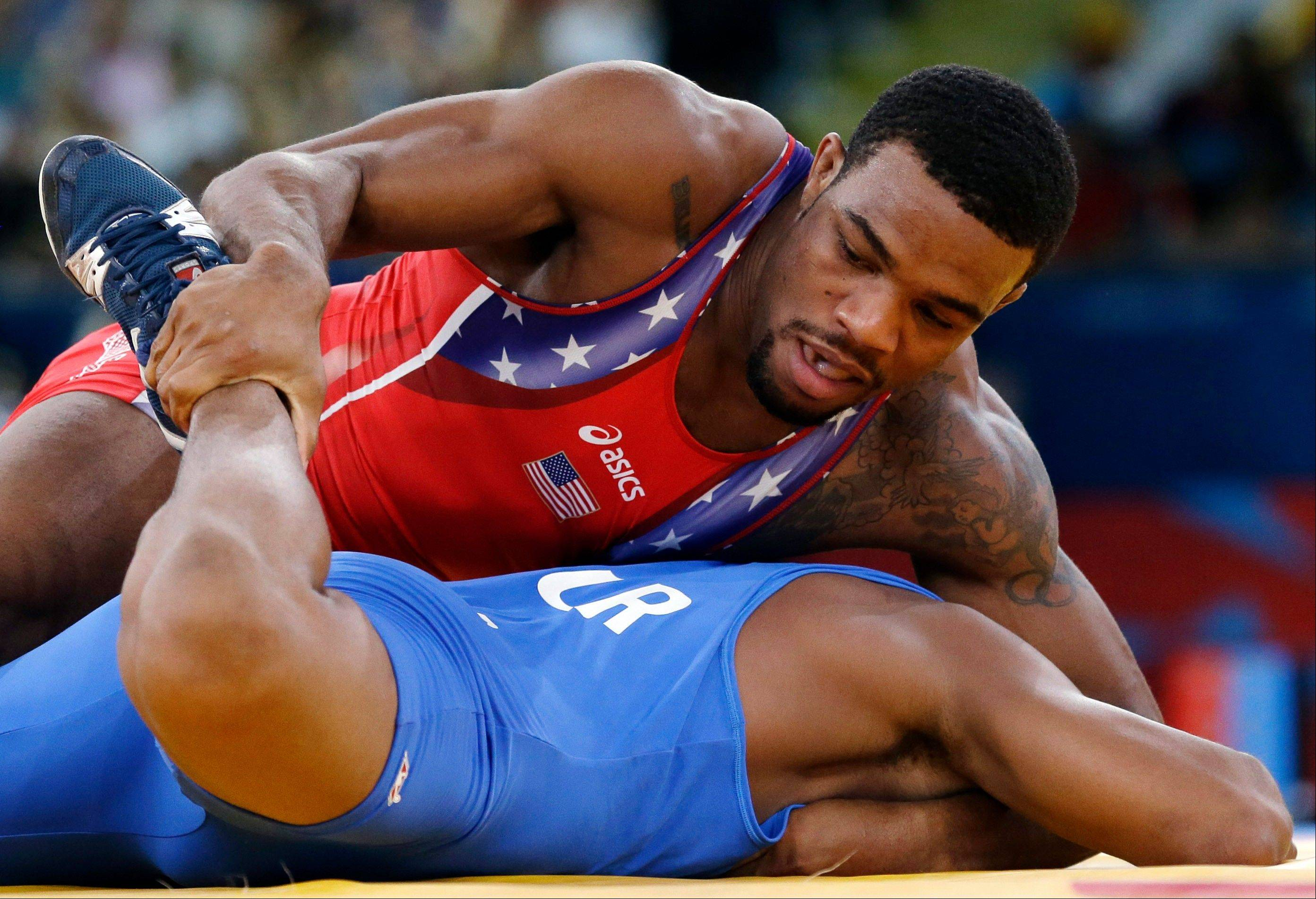 The United States' Jordan Ernest Burroughs, in red, and Puerto Rico's Francisco Daniel Soler Tanco compete in a 74-kg men's freestyle match at the 2012 Summer Olympics in London. Wrestling is hoping to be included into the 2020 Olympic Games.