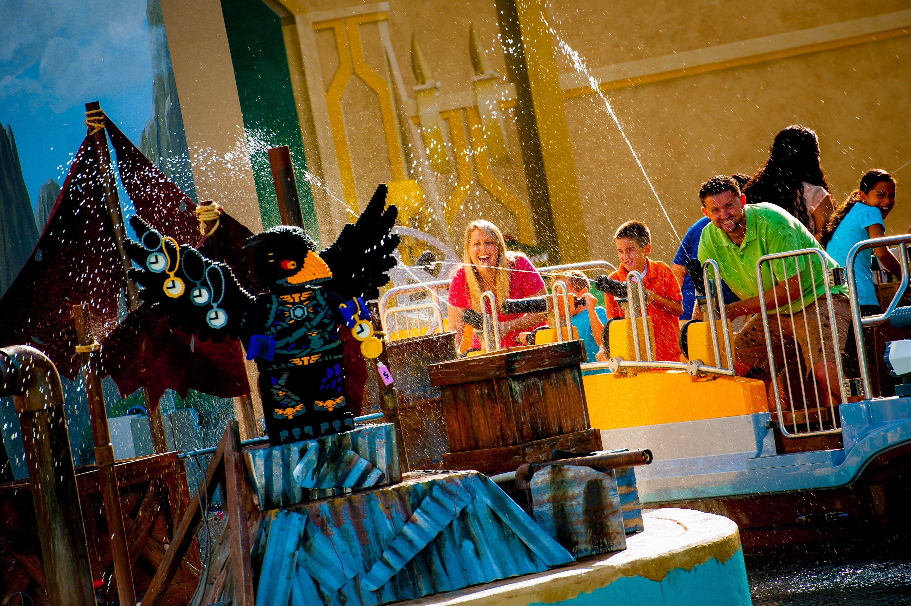 Families at Legoland Florida enjoy the theme park�s new interactive water ride, The Quest for Chi. This is one of several attractions that opened at theme parks this summer.