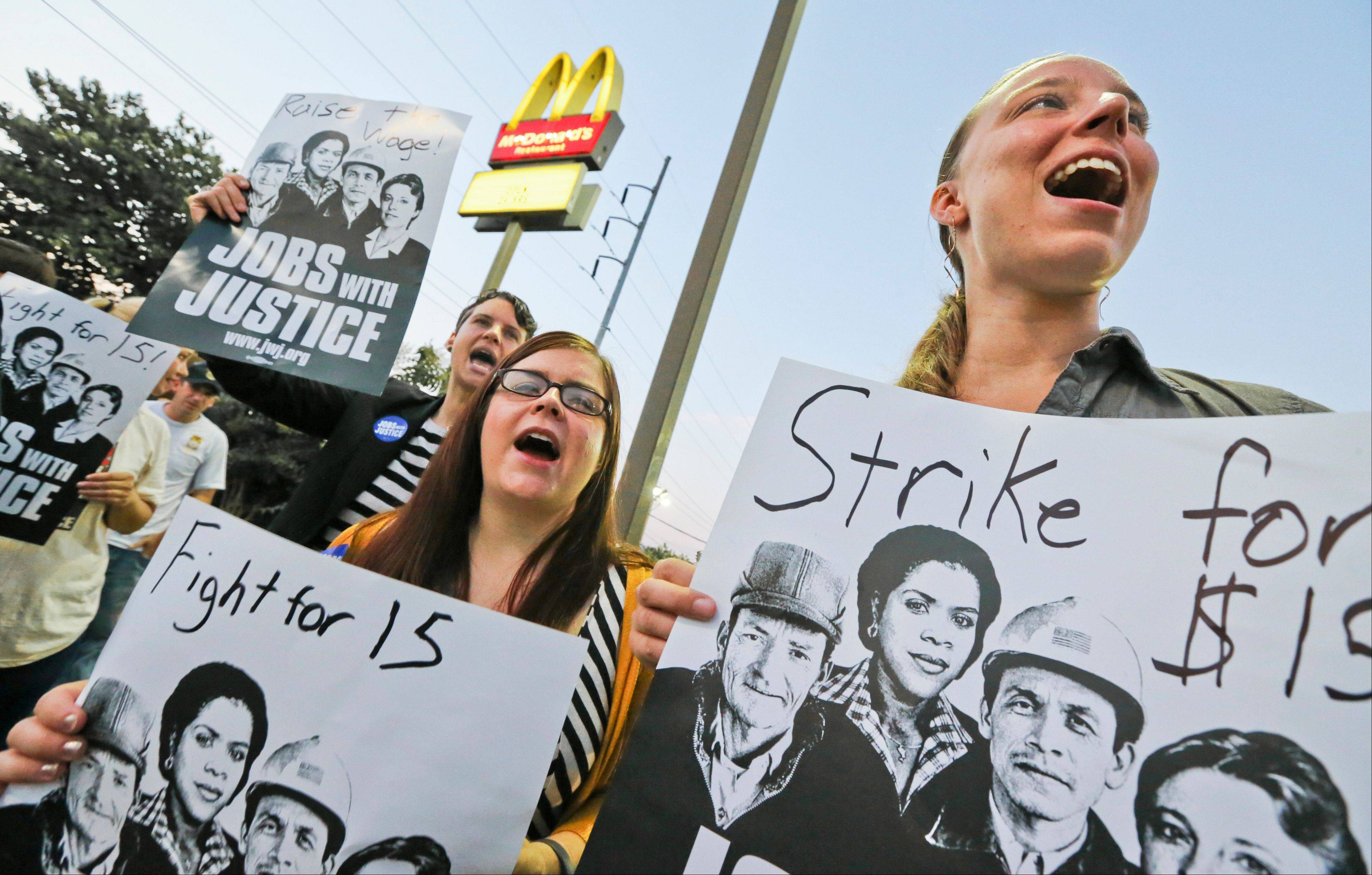 A protest takes place in front of a McDonald�s in Atlanta on Aug. 29. Thousands of fast-food workers and their supporters have been staging protests across the country to call attention to the struggles of living on or close to the federal minimum wage.