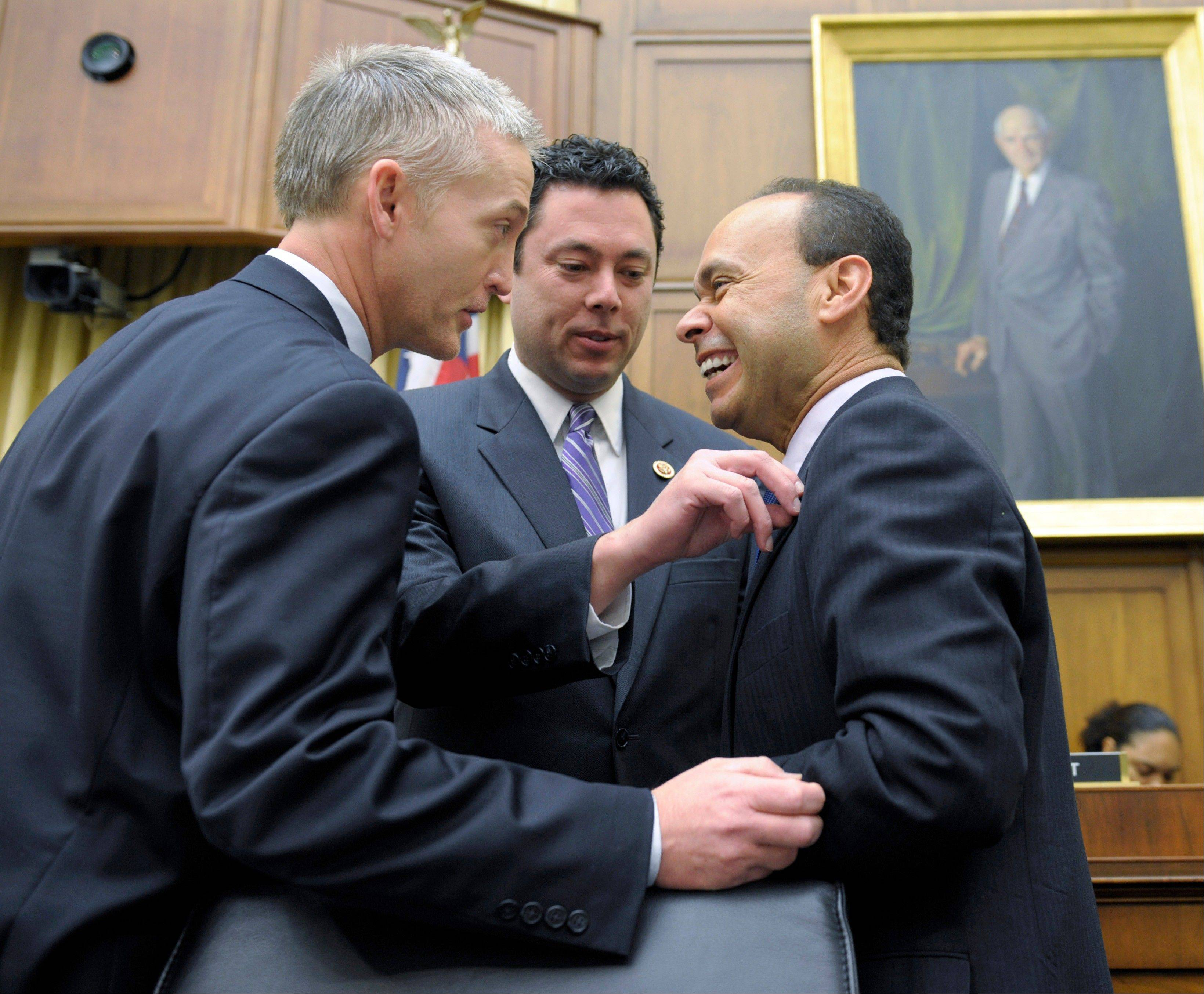 House Judiciary Committee members Rep. Jason Chaffetz, a Utah Republican, center, Rep. Luis Gutierrez, a Chicago Democrat, right, and Rep. Trey Gowdy, a South Carolina Republican, share a laugh prior to a committee hearing on immigration reform last Feb. 5. The question central to immigration legislation is whether the 11 million immigrants already in the U.S. illegally should get a path to citizenship.