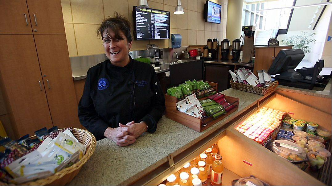 Elgin Community College Food Services Director Maria Terry shows some of ECC�s redesigned Food for Thought Cafe, which opened for the fall semester with a completely new, healthy menu.