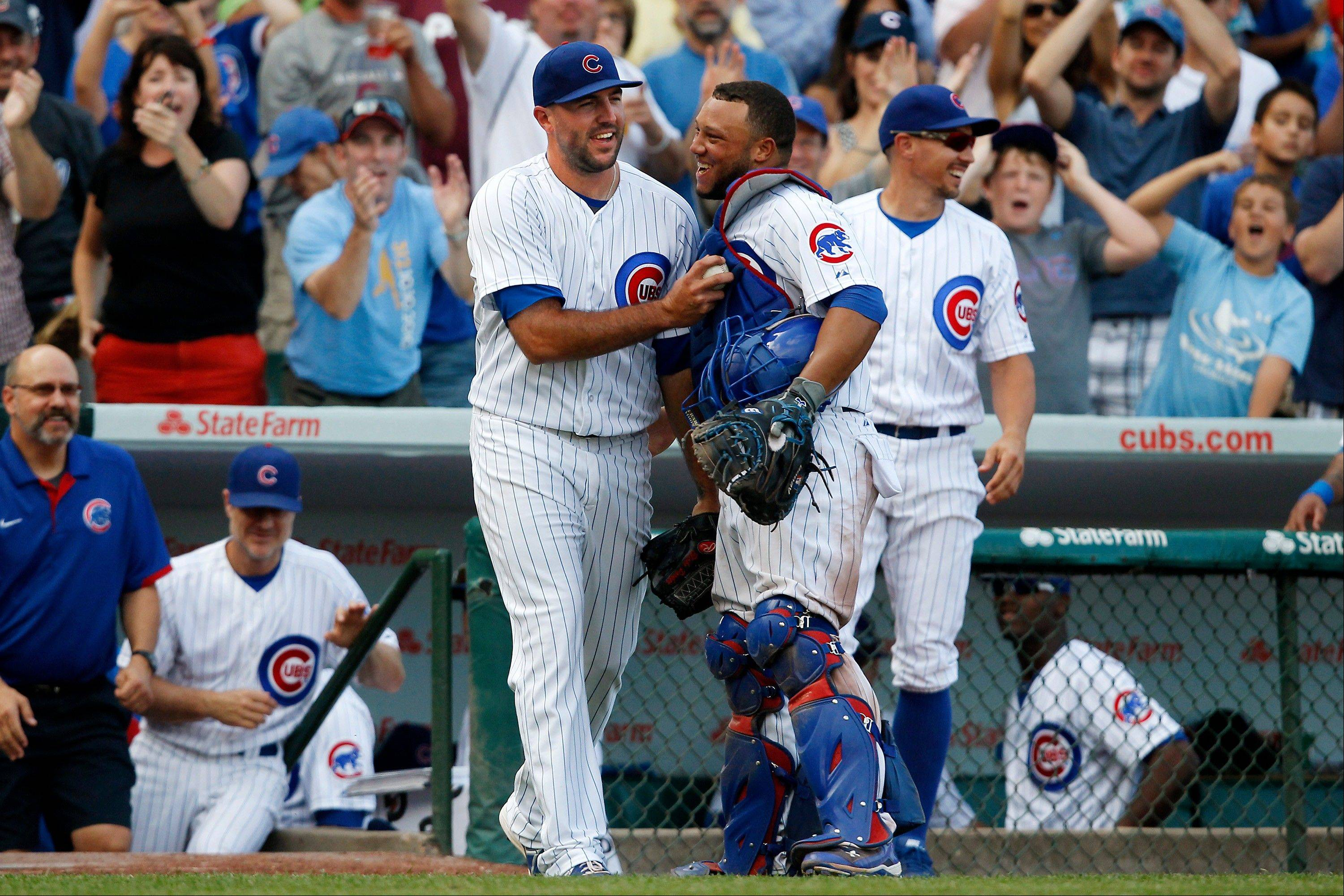 Chicago Cubs relief pitcher Blake Parker, front left, and catcher Welington Castillo celebrate after their 7-1 victory over the Philadelphia Phillies in a baseball game on Sunday, Sept. 1, 2013, in Chicago.
