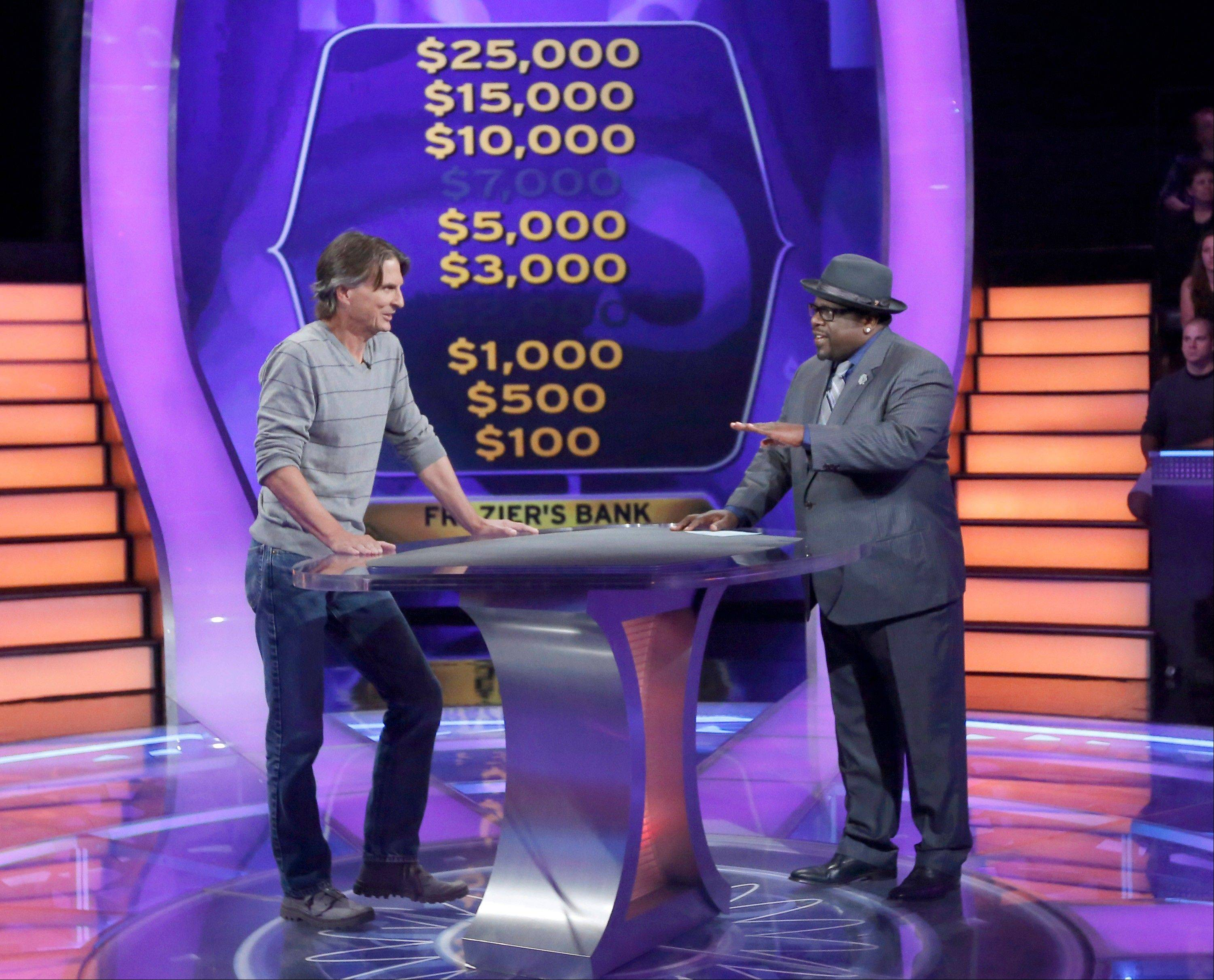 "Associated Press writer Frazier Moore, left, interacts with host Cedric ""The Entertainer"" during a test show of the game show ""Who Wants to be a Millionaire."" The new season premieres on Monday, Sept. 2"