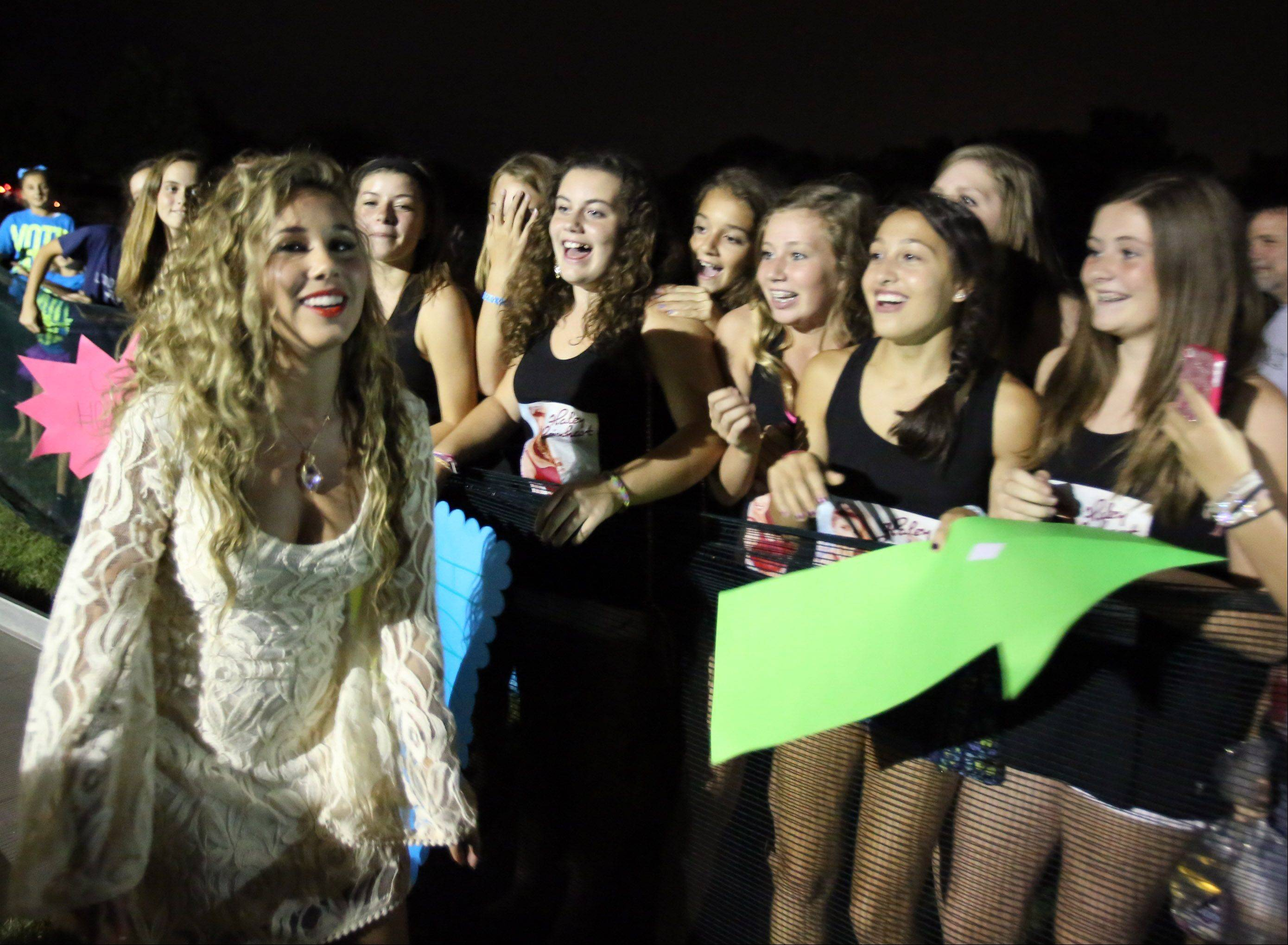 Former American Idol finalist Haley Reinhart greets fans before preforming with her family band, Midnight, at Buffalo Grove Days in Buffalo Grove on Saturday.