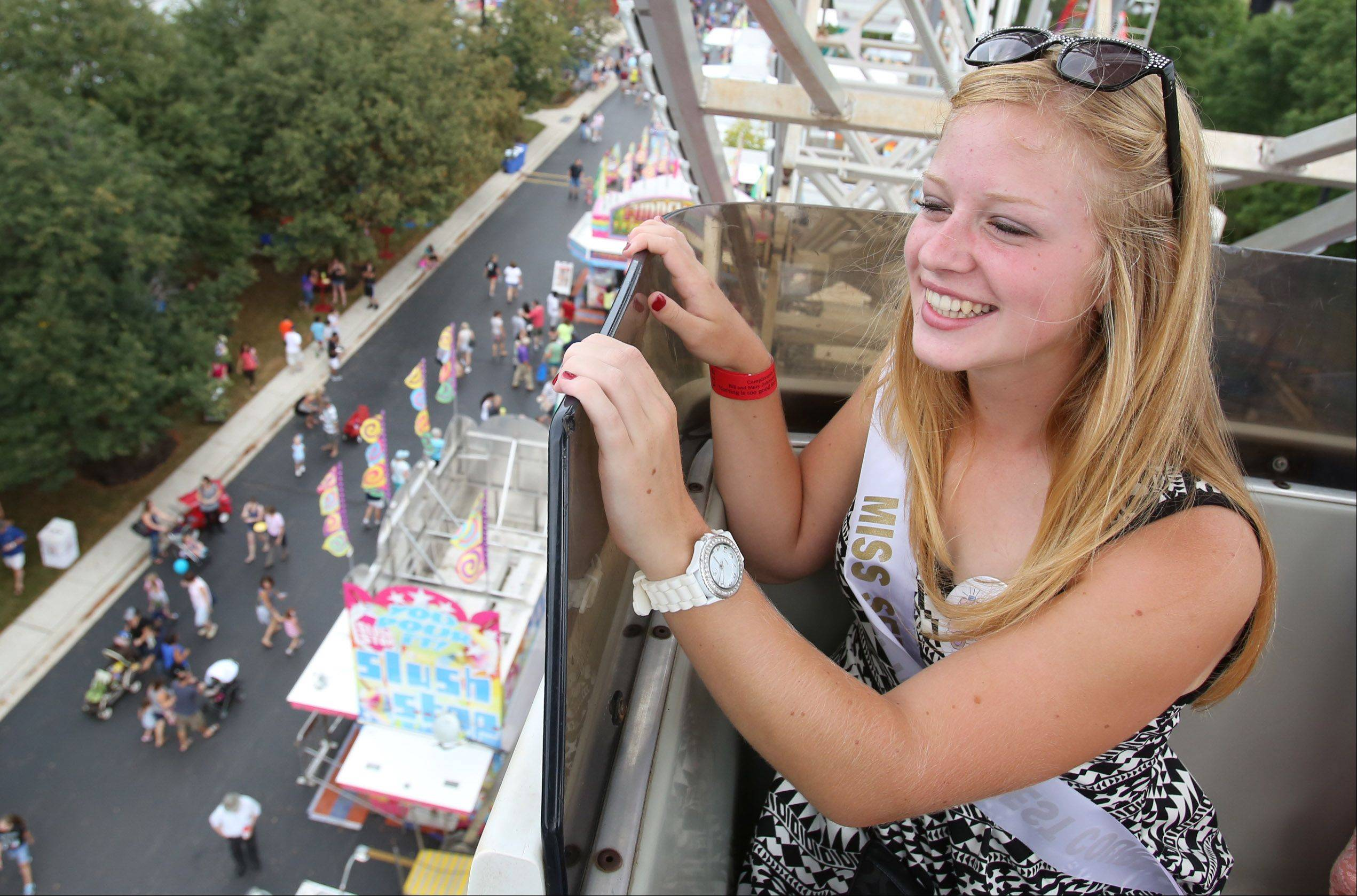 Carly Bryeans, 16, of Schaumburg, a member of the Miss Schaumburg Septemberfest court, rides the ferris wheel at Schaumburg Septemberfest at the Robert O. Atcher Municipal Grounds in Schaumburg on Saturday.