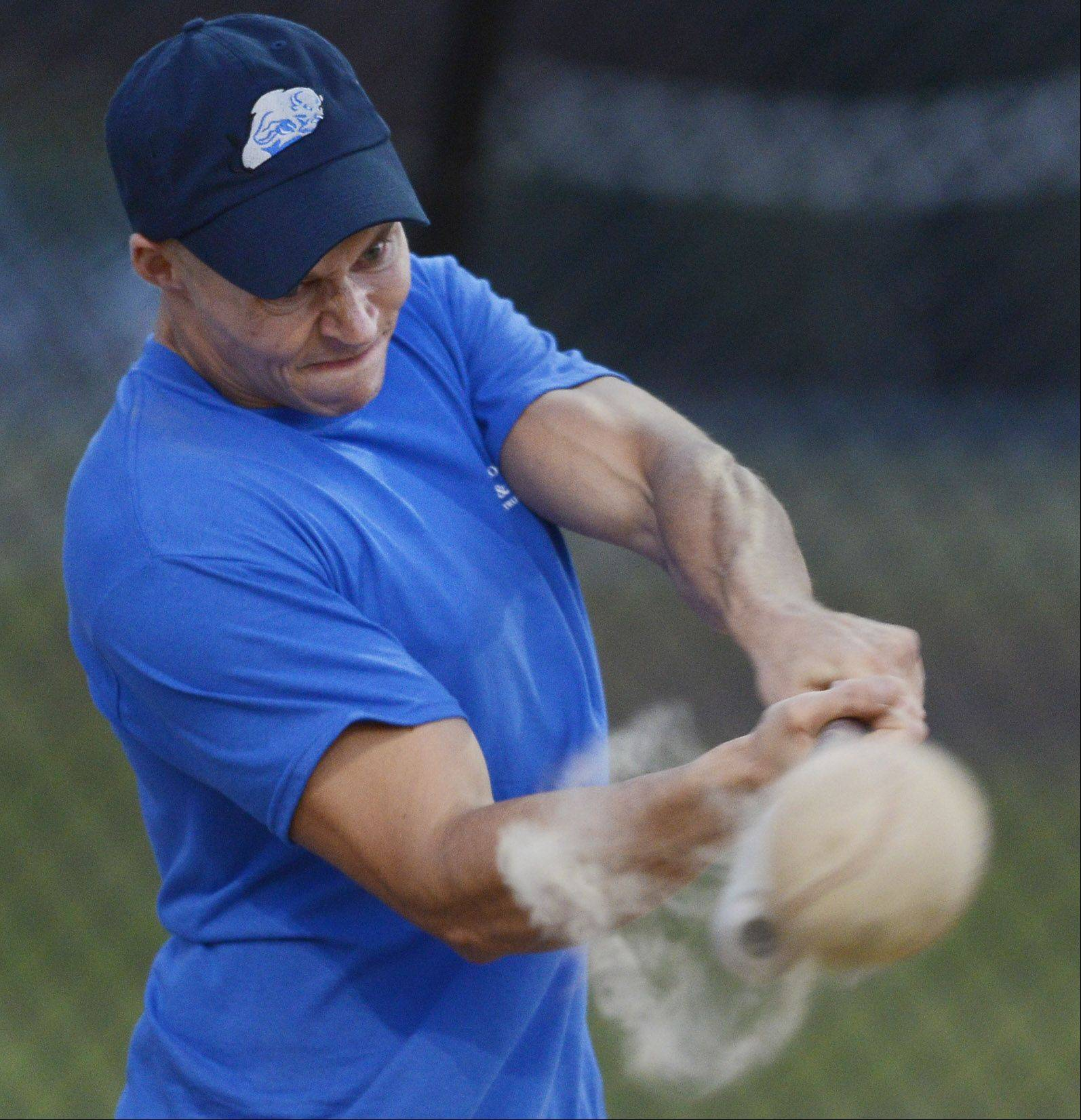 Cody Barker of B&B Services, Buffalo Grove, hits a bases-loaded double during Wednesday's annual charity softball game at Emmerich Park in Buffalo Grove.