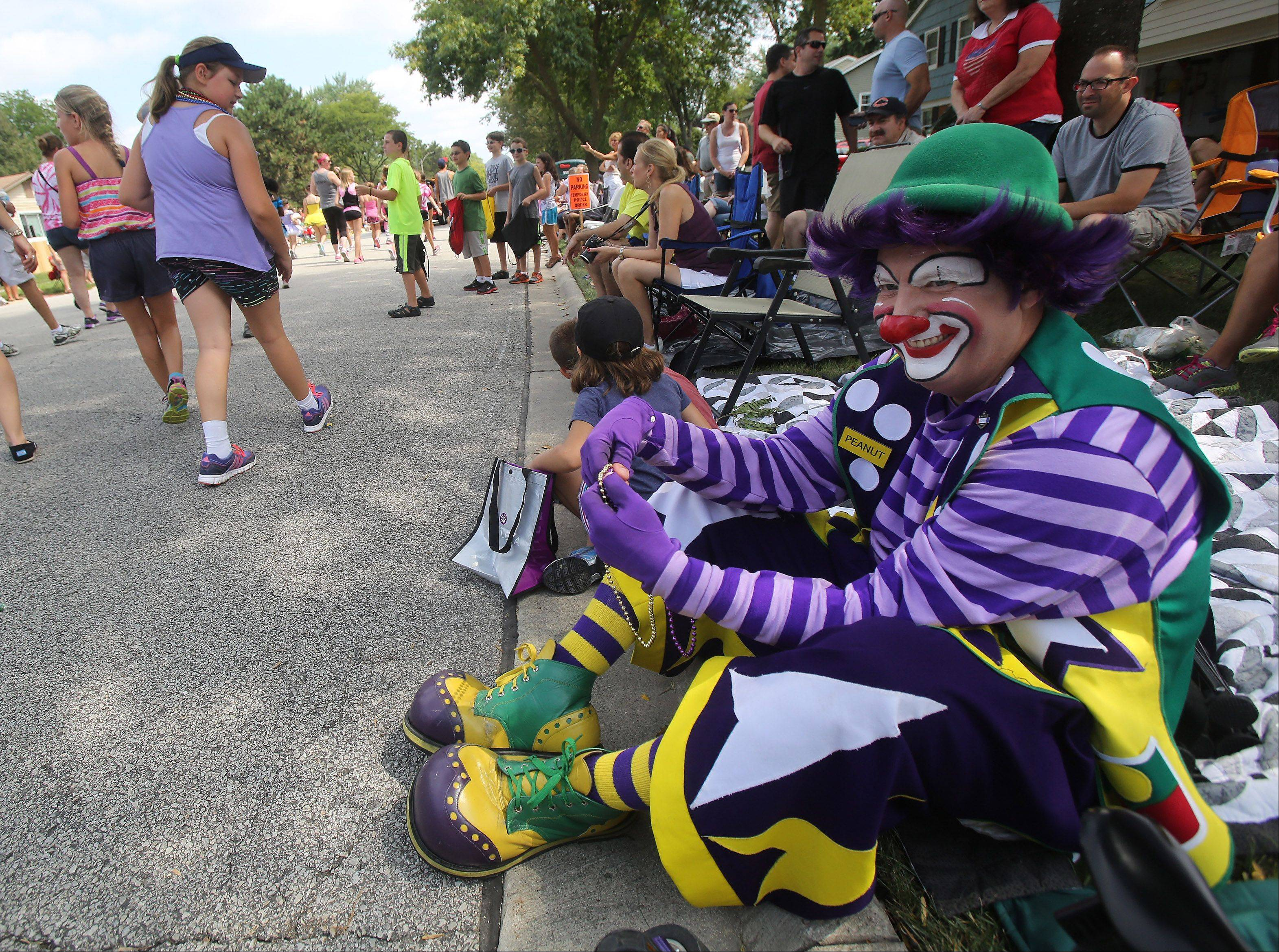 "Medinah Shrine Clown ""Peanut"" watches from the curb with Lia Drazin, 5, of Arlington Heights and her brother Elliott, 7, during the Buffalo Grove Days parade."