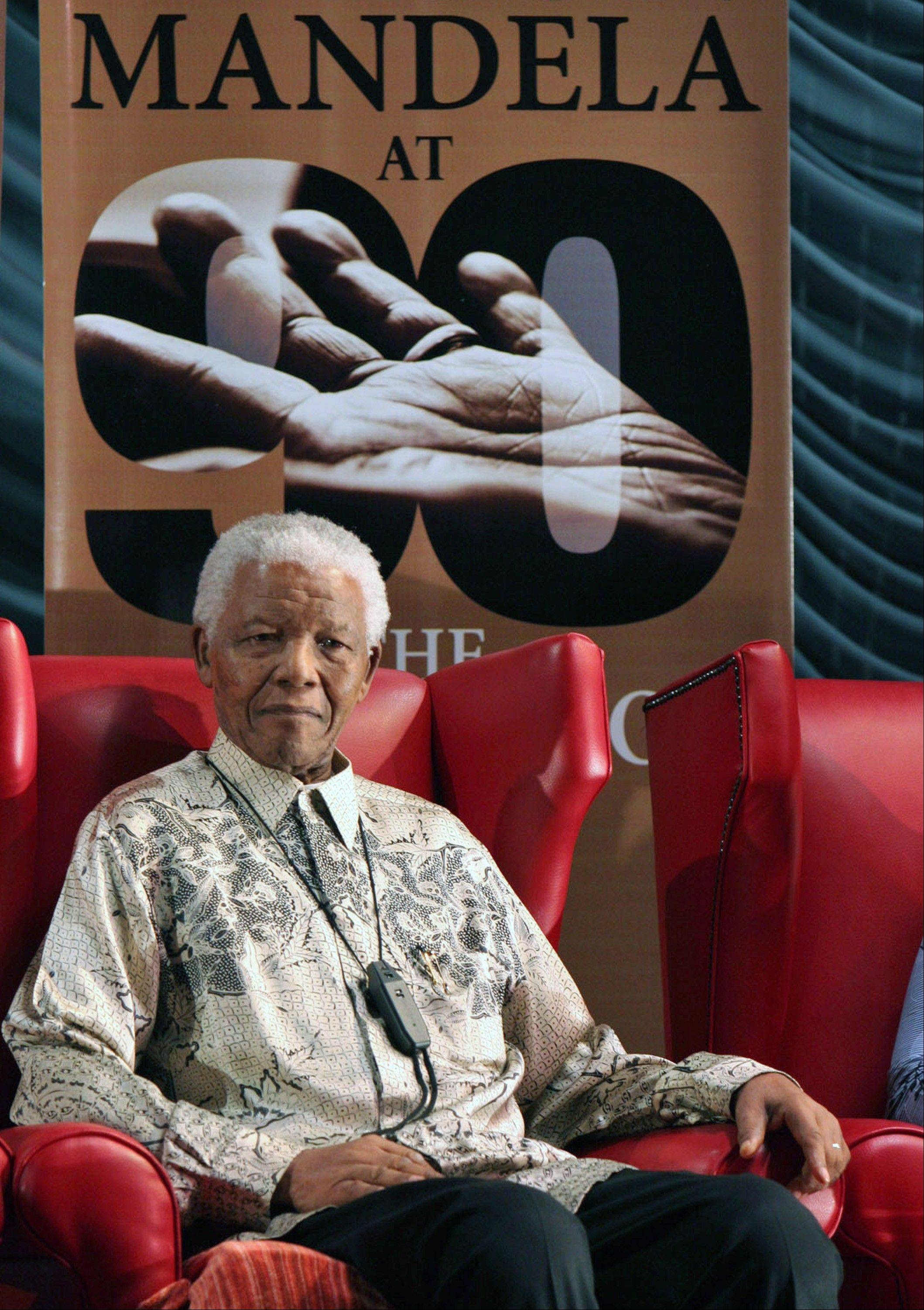 Former South African President Nelson Mandela, seen here in a photo from 2008, was discharged from the hospital Sunday. He has been treated for months with a recurring lung infection.