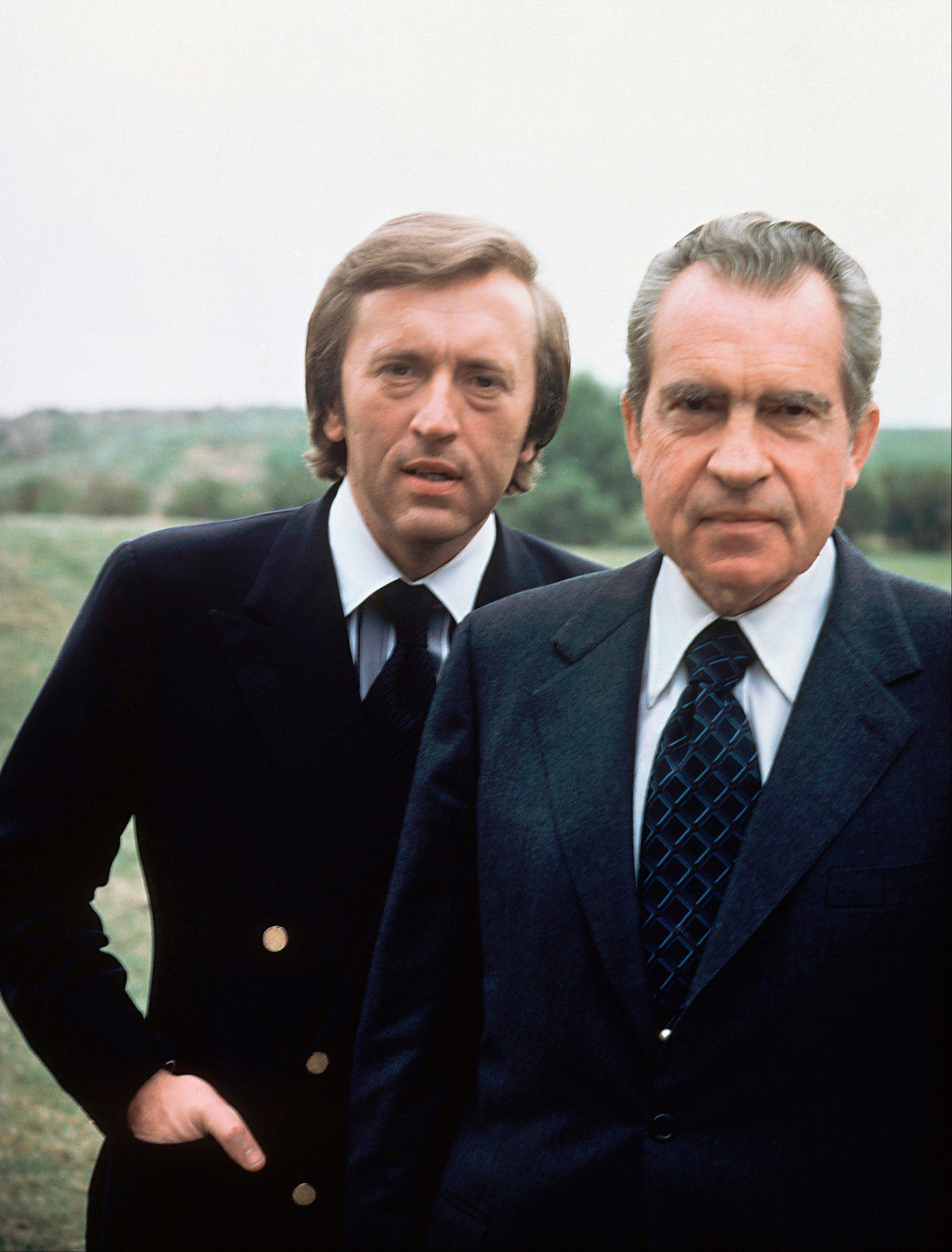 Former President Richard M. Nixon, right, with broadcaster David Frost are seen in 1977. Frost has died at the age of 74 his family said in a statement Sunday.