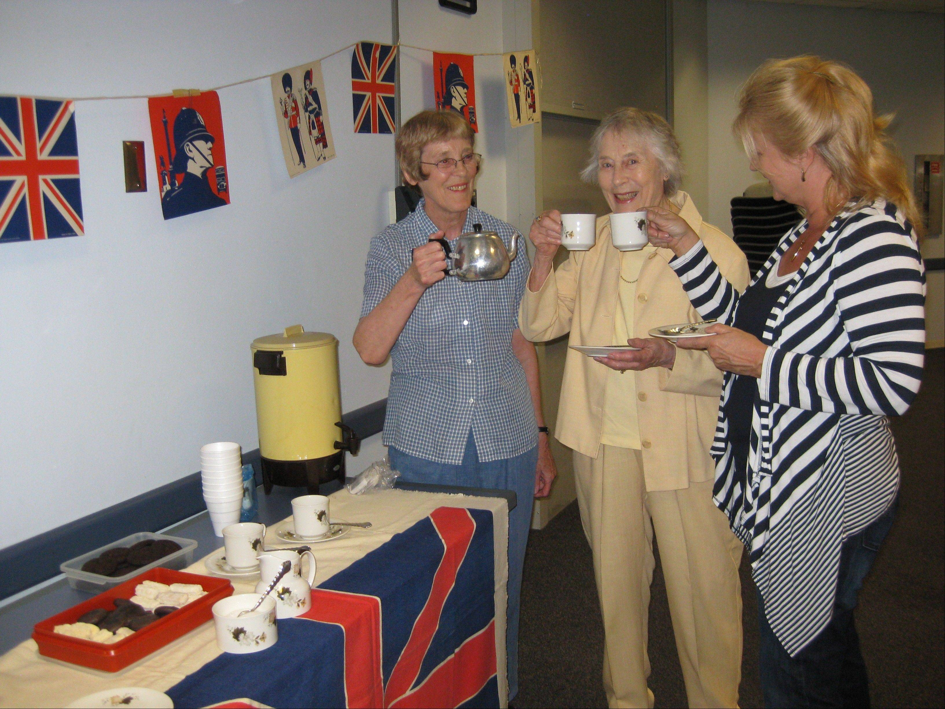 Jill Hauser, regent of the Naperville chapter of the Daughters of the British Empire USA, pours tea for member Shelia Brown and Georgina Dirker, a visitor from St. Charles, at a recent DBE meeting.