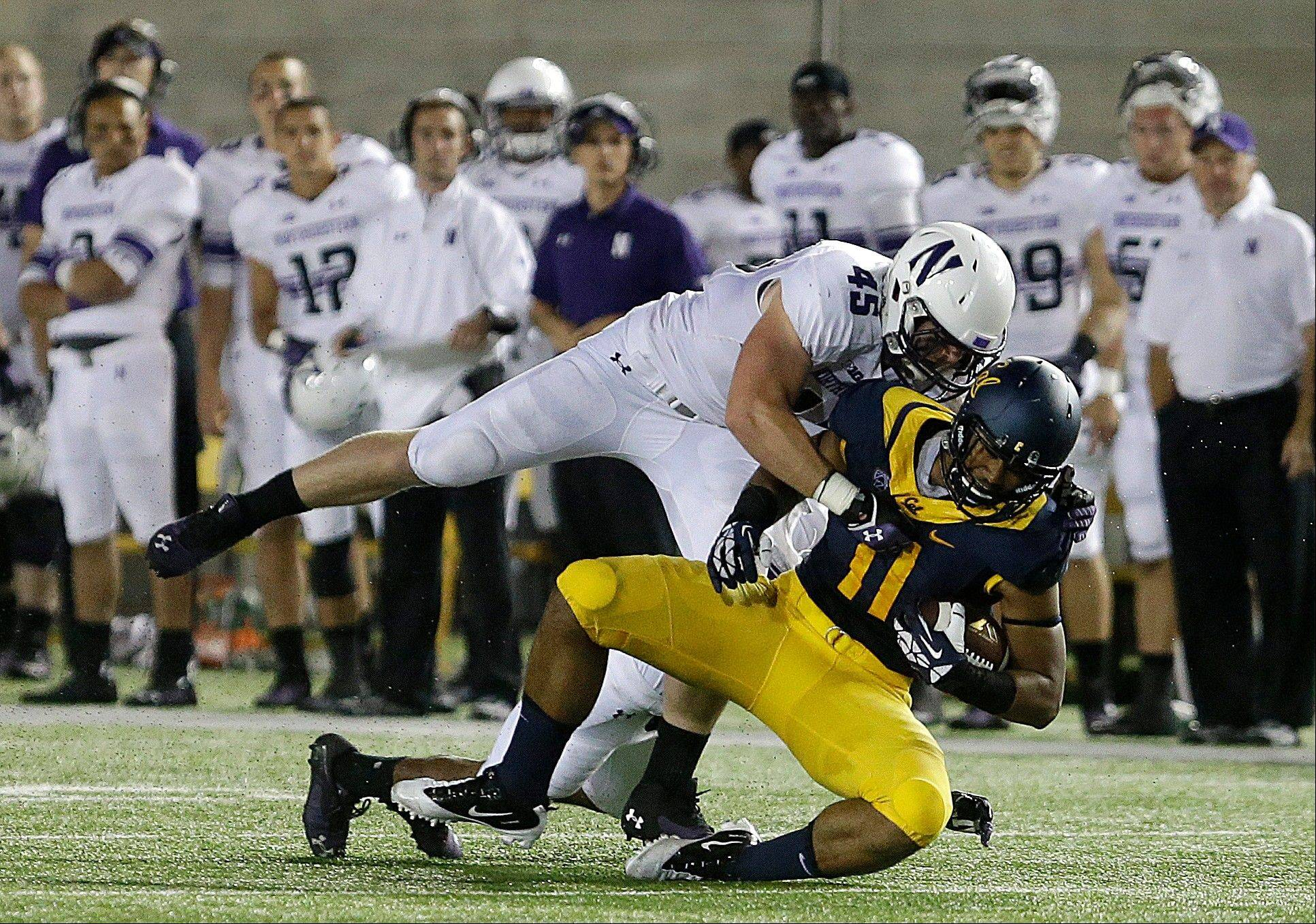Northwestern's Collin Ellis (45) tackles California's Richard Rodgers (11) during the second half of an NCAA college football game on Saturday, Aug. 31, 2013, in Berkeley, Calif.