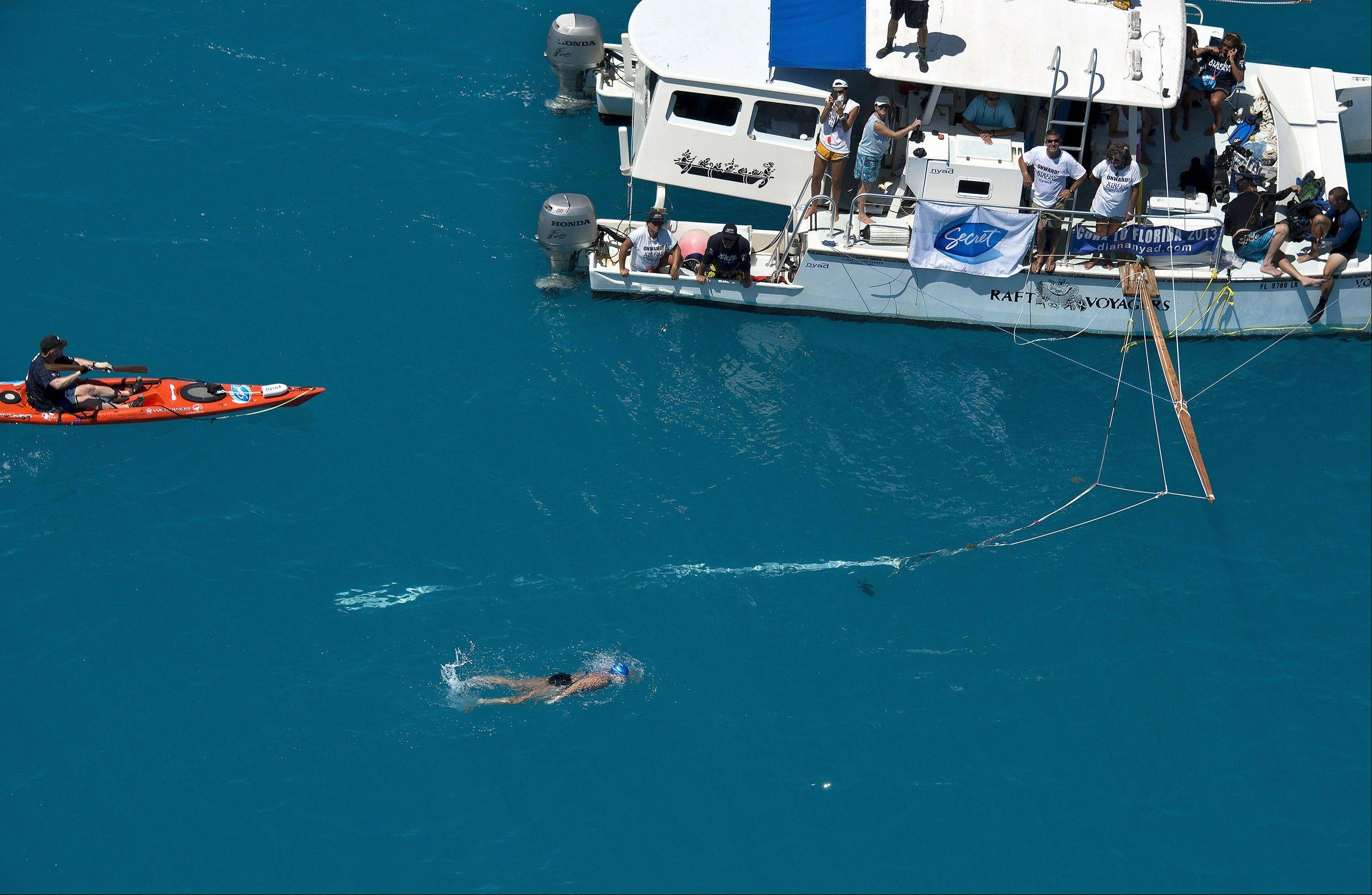 In this photo provided by the Florida Keys News Bureau, Diana Nyad, positioned about two miles off Key West, Fla., Monday, Sept. 2, 2013, swims towards the completion of her approximately 110-mile trek from Cuba to the Florida Keys.
