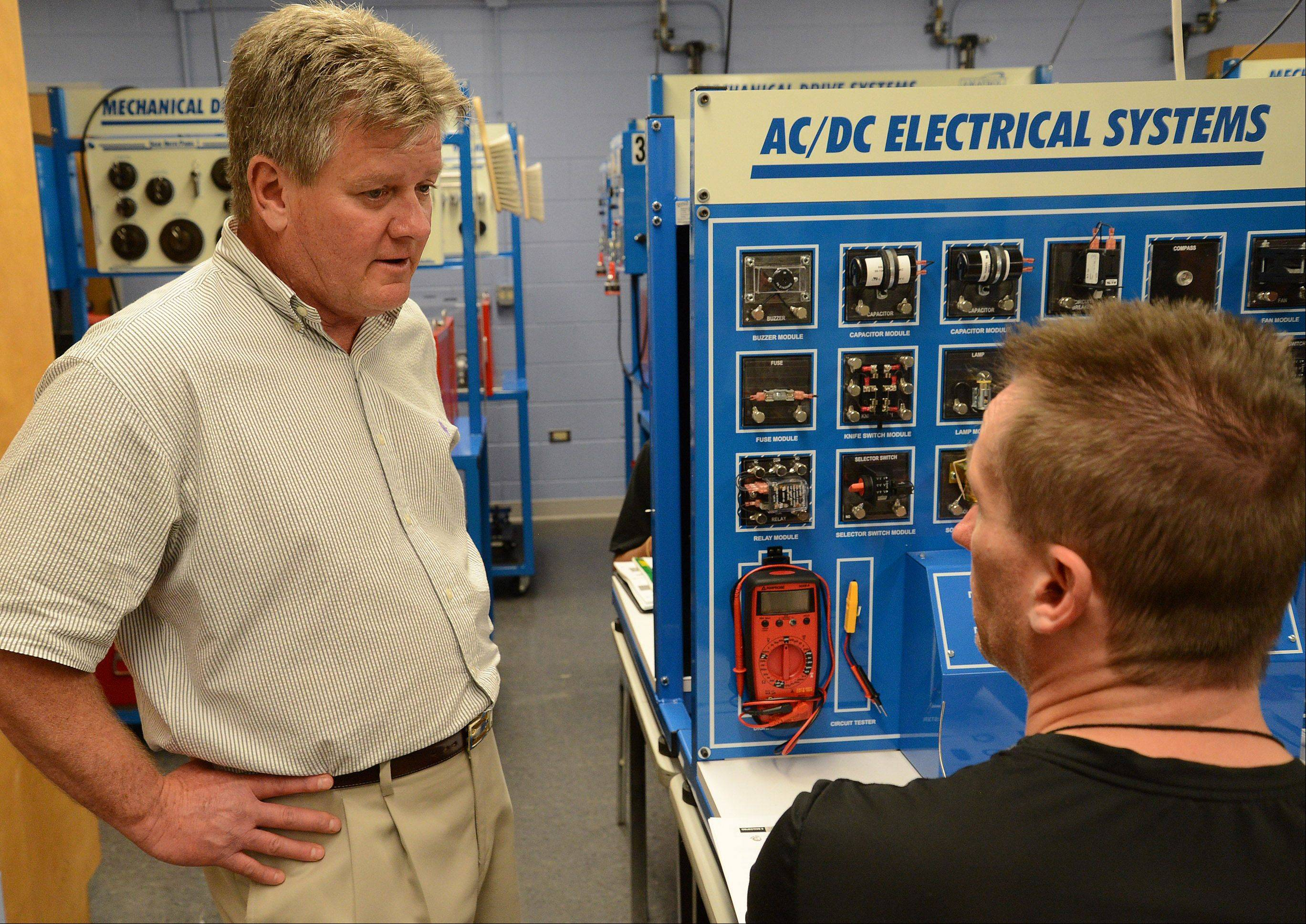 Dean Emeritus Gary Morgan explains mechatronics. The new program is part of a College of Lake County effort to help bring skilled workers to local manufacturing businesses looking for employees.