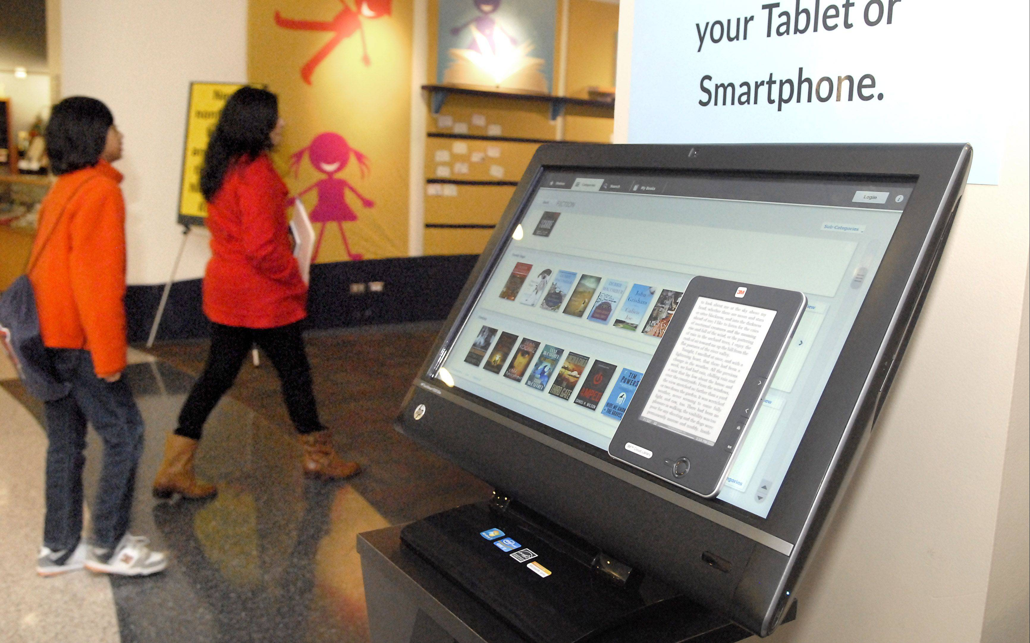 Gail Borden Public Library�s main location in Elgin has a 3M Cloud Library that allows patrons to download e-books wirelessly. Librarians say getting e-books from publishers, however, remains a challenge.