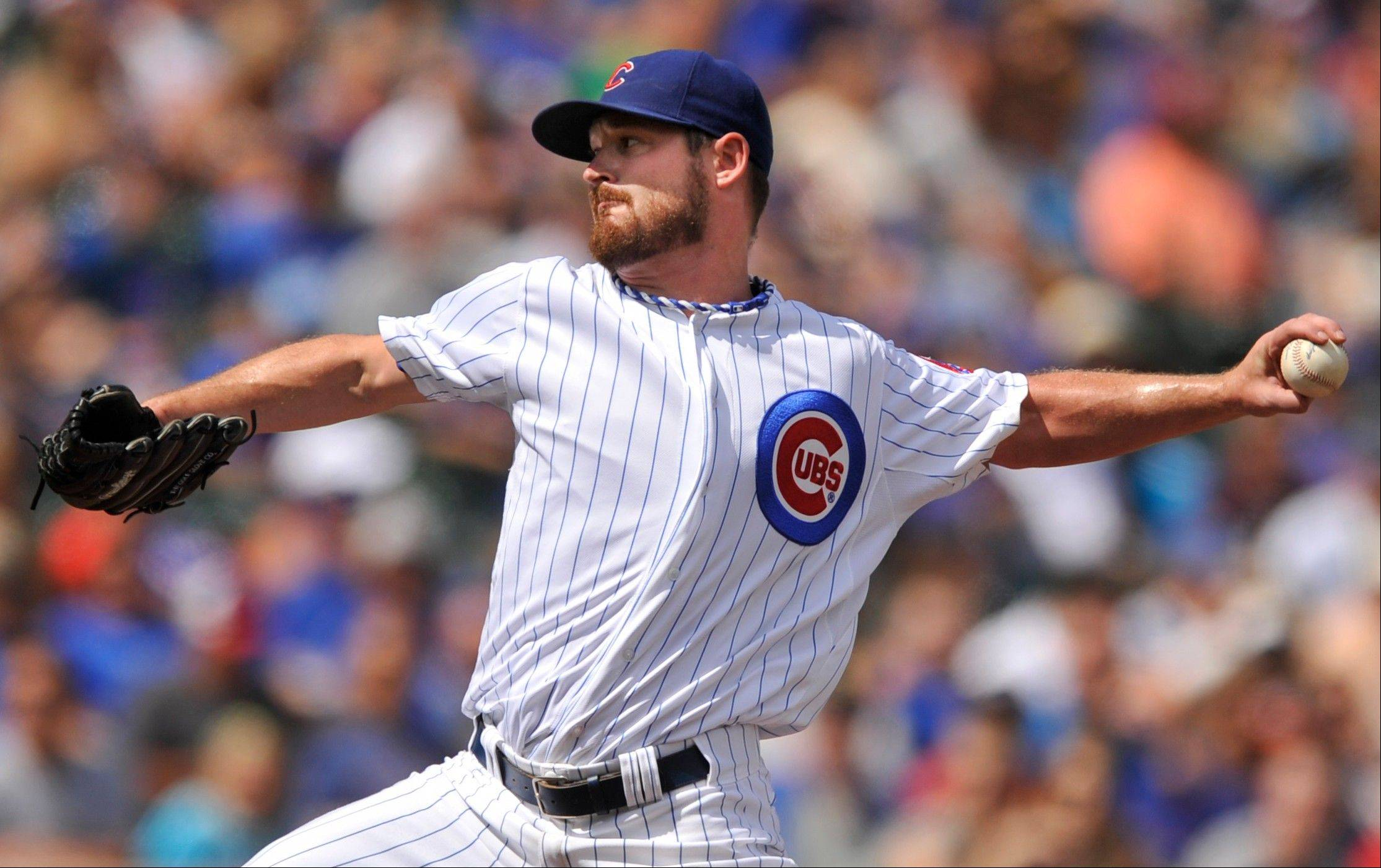 Cubs starter Travis Wood delivers a pitch during the first inning of a baseball game against the Miami Marlins in Chicago, Monday, Sept. 2, 2013, at Wrigley Field.