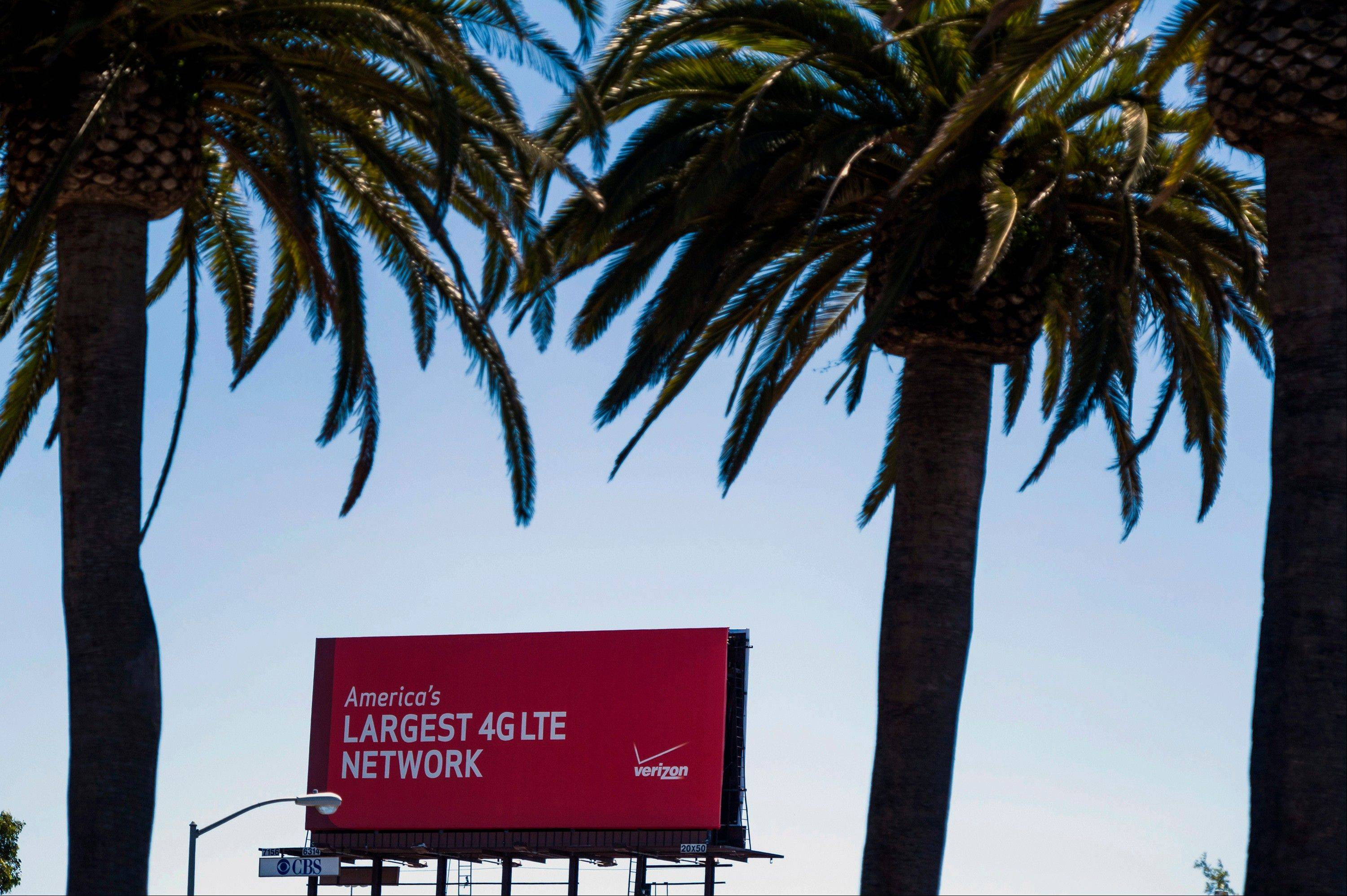 A Verizon Wireless billboard stands in San Francisco, California, U.S. on Thursday Aug. 29, 2013. Verizon Communications Inc.'s buyout of the rest of its wireless venture may yield more than