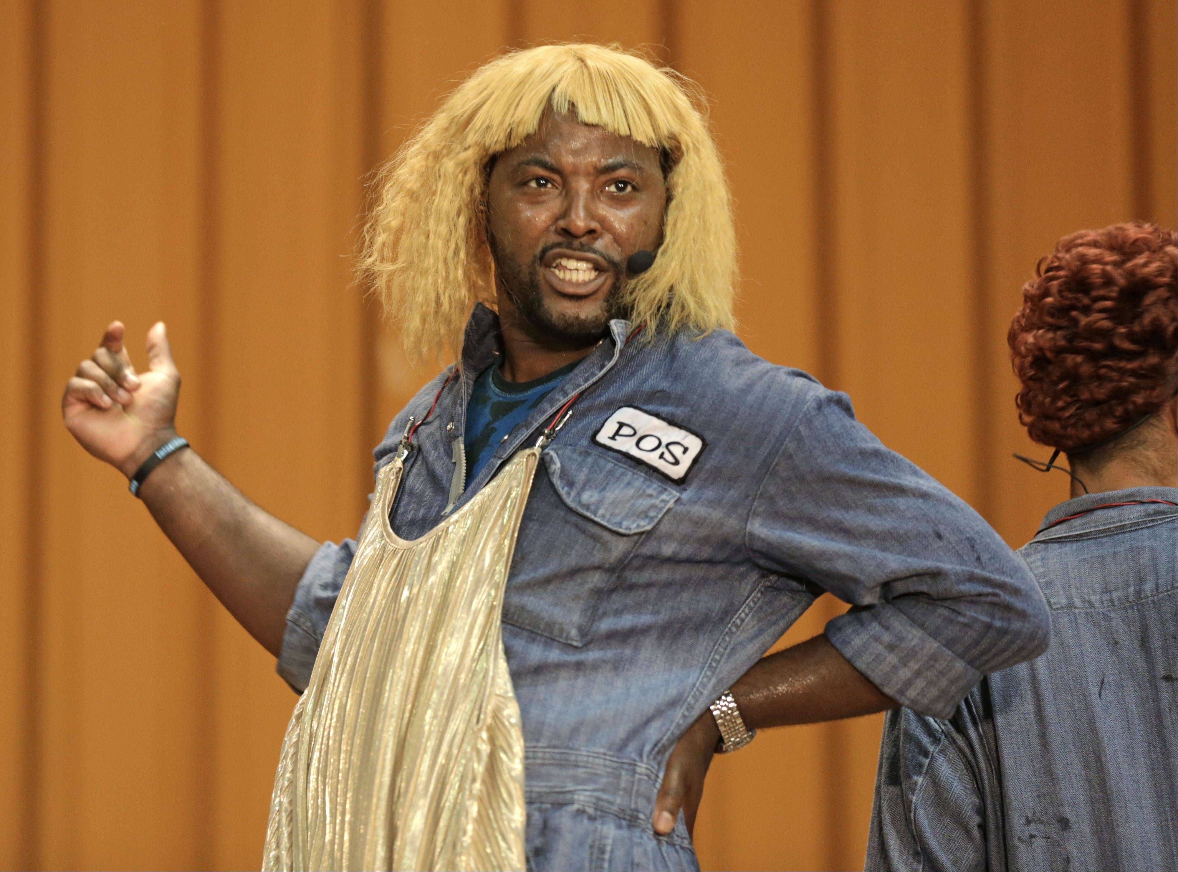 "Rapper Postell Pringle wears a wig as he performs in a hip hop adaptation of William Shakespeare's Othello, titled ""Othello: The Remix"" at the Cook County Jail."