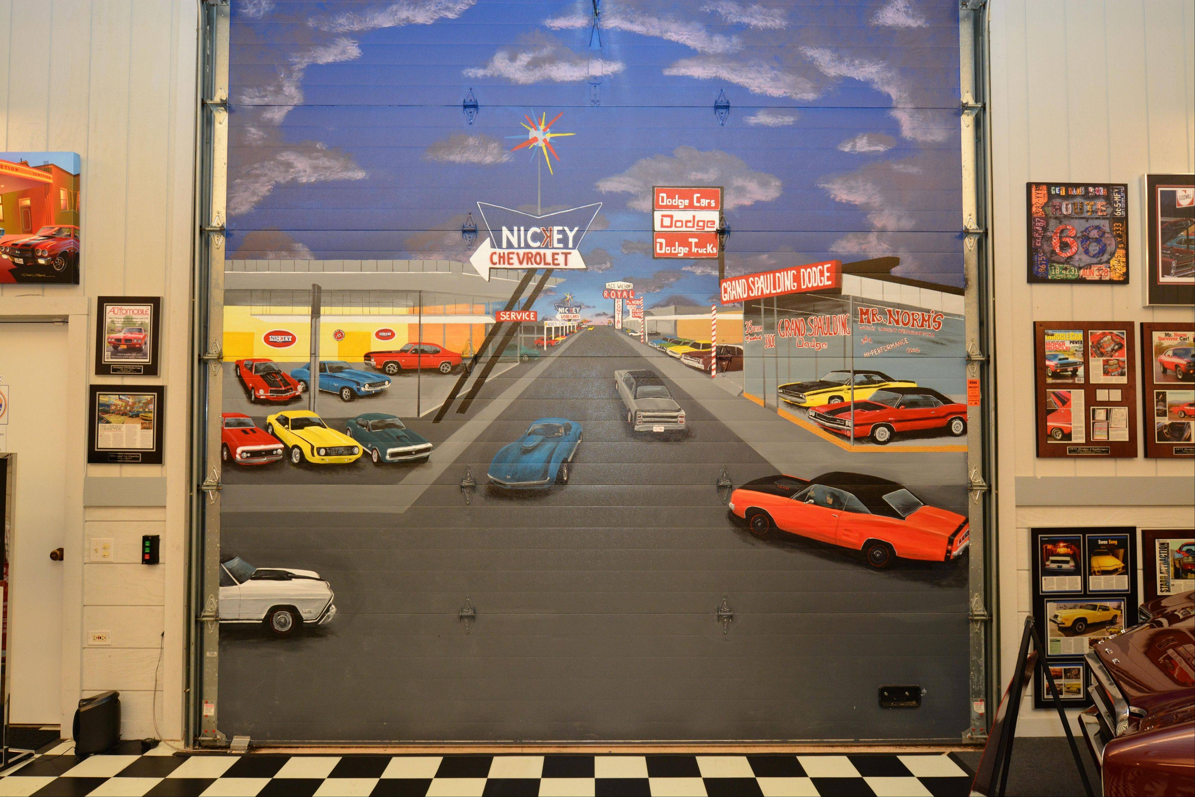 A mural painted on the garage door depicts some of Mike's treasured cars and precious memories.