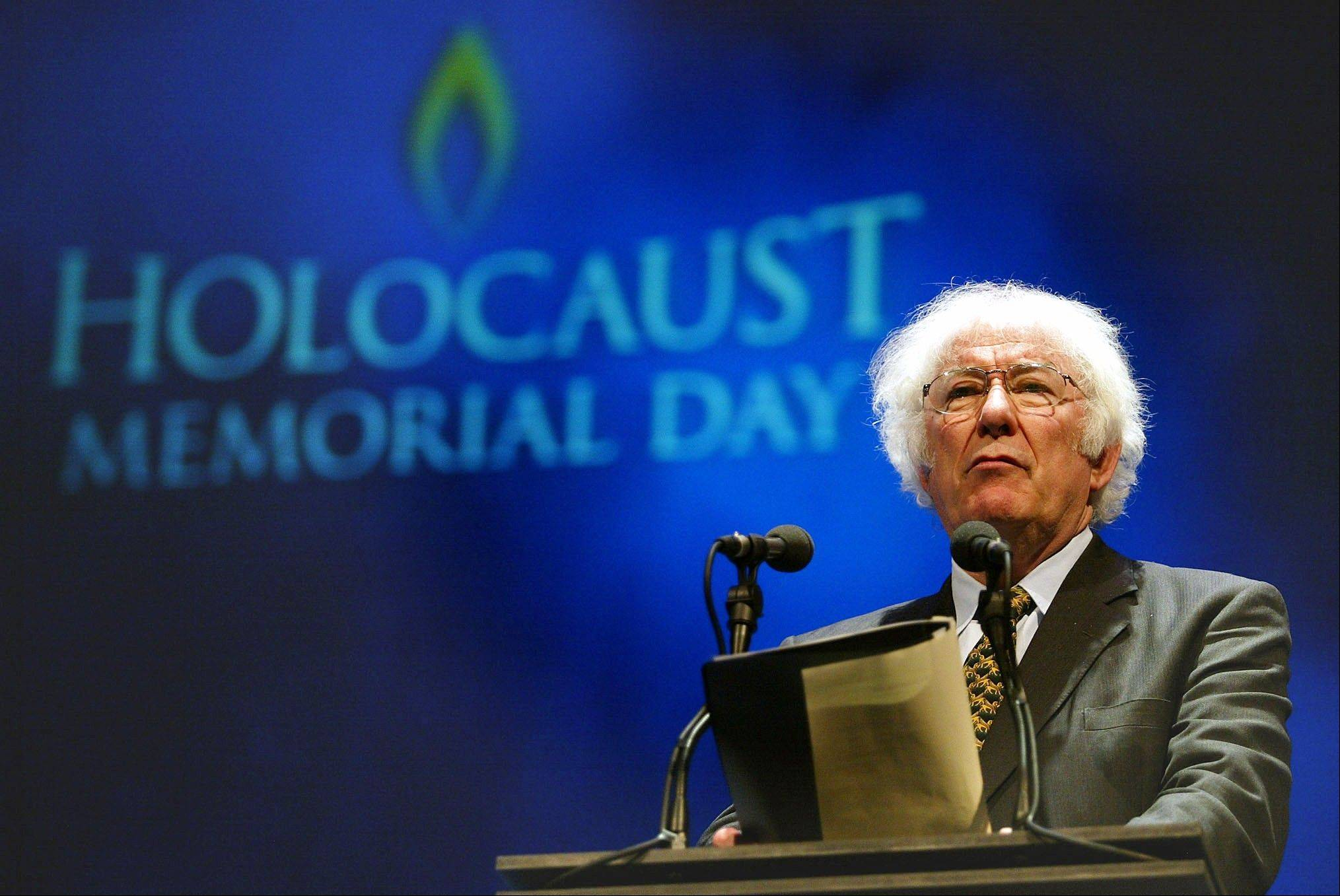 A Tuesday, Jan. 27, 2004 photo from files showing former Nobel Prize winning poet Seamus Heaney speaking during a rehearsal for the Northern Irish national Holocaust commemoration at the Waterfront Hall, Belfast, Northern Ireland. Seamus Heaney, Irelandís foremost poet who won the Nobel literature prize in 1995, has died after a half-century exploring the wild beauty of Ireland and the political torment within the nationís soul.