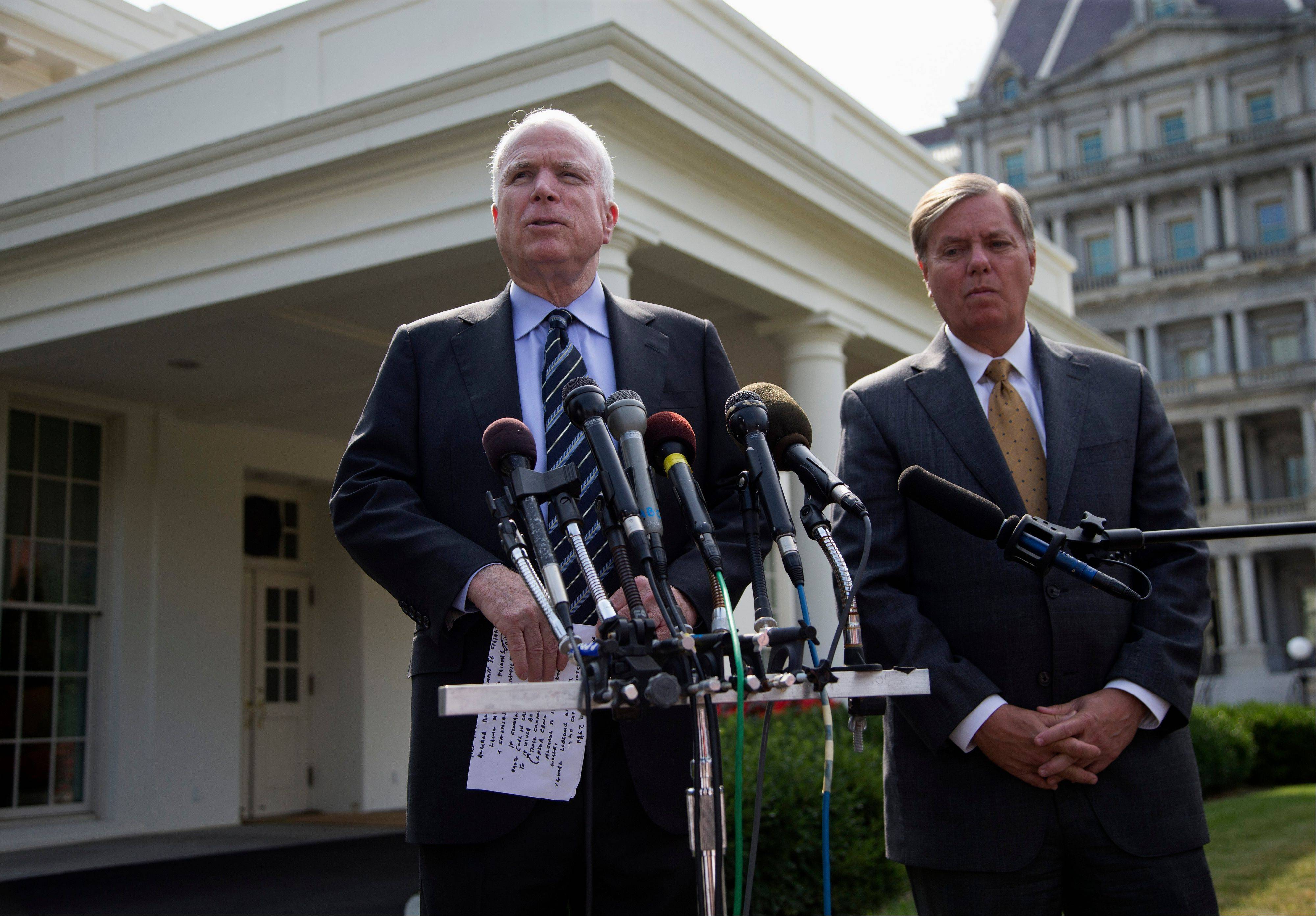 Sen. John McCain, left, accompanied by Sen. Lindsey Graham, speaks with reporters outside the White House in Washington, Monday, Sept. 2, 2013, following a closed-door meeting with President Barack Obama to discuss the situation with Syria.