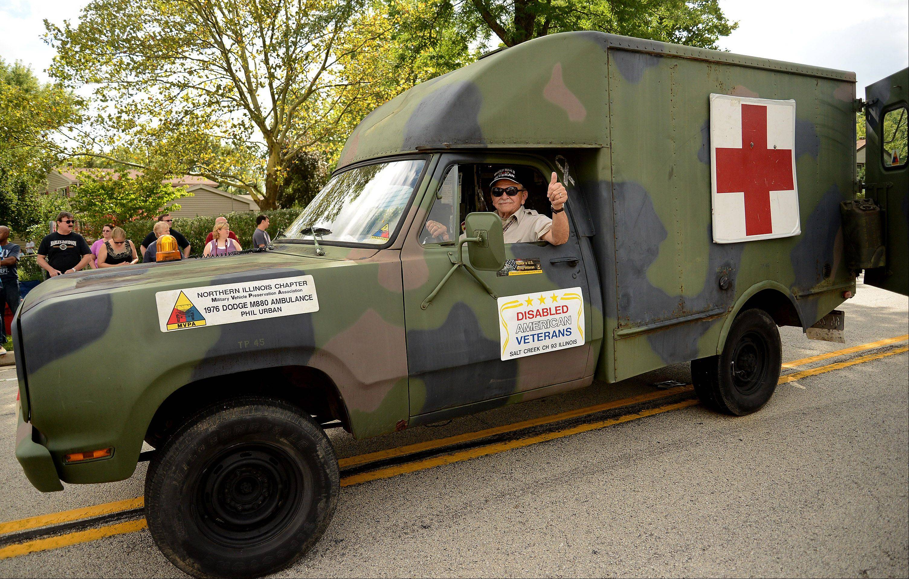 World War II Veteran Phil Urban drives his 1976 Vietnam era ambulance in the annual Schaumburg Septemberfest parade Monday.