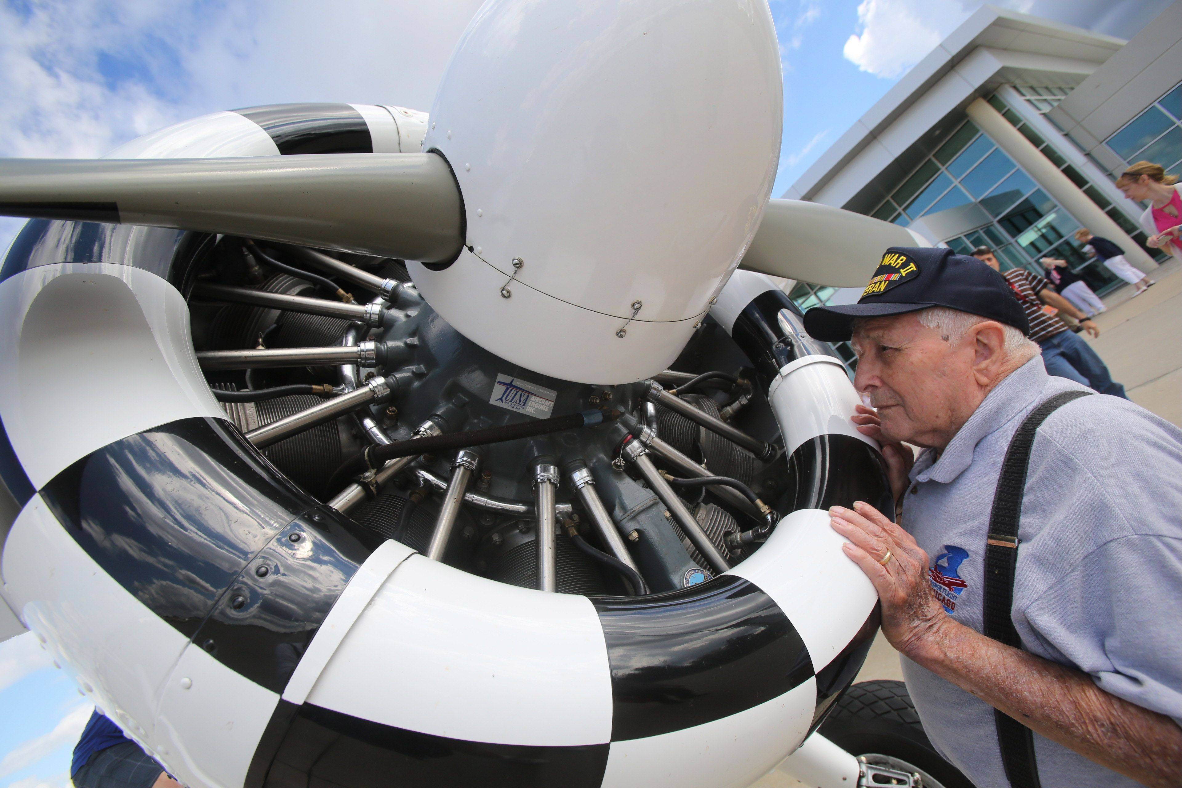 Former World War II airplane mechanic Tony Thomas, 91, looks at the engine of a 1942 Boeing Stearman before flying in it Monday at Chicago Executive Airport in Wheeling.