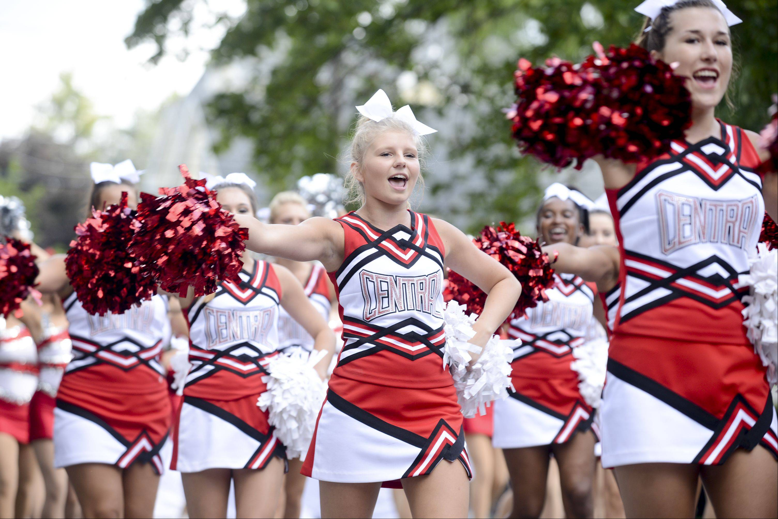 Naperville Central High School's pom team march and perform in the Labor Day parade that kicked off the last day of the annual Last Fling in Naperville.