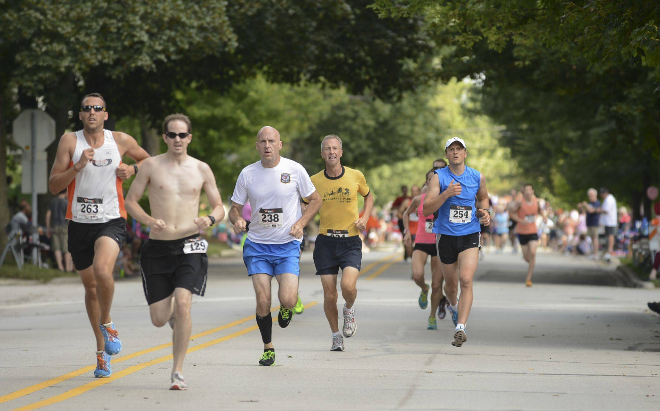 Runners participate in the Fling Mile on Monday morning during the Last Fling festival in Naperville.