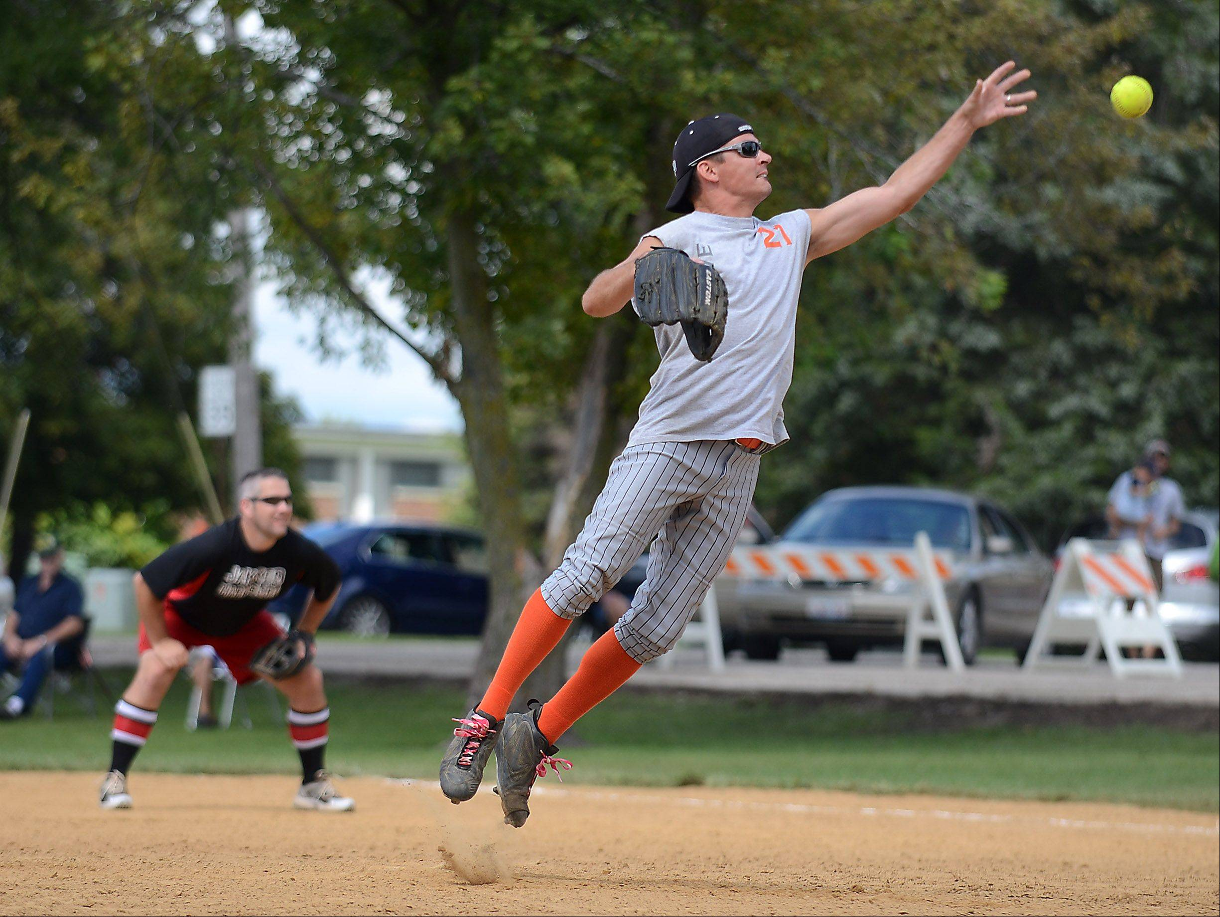 Jim Witok of the R3 Creative team delivers a jump pitch during the slow pitch softball tournament that wraps up Maple Park's annual Fun Fest Monday.