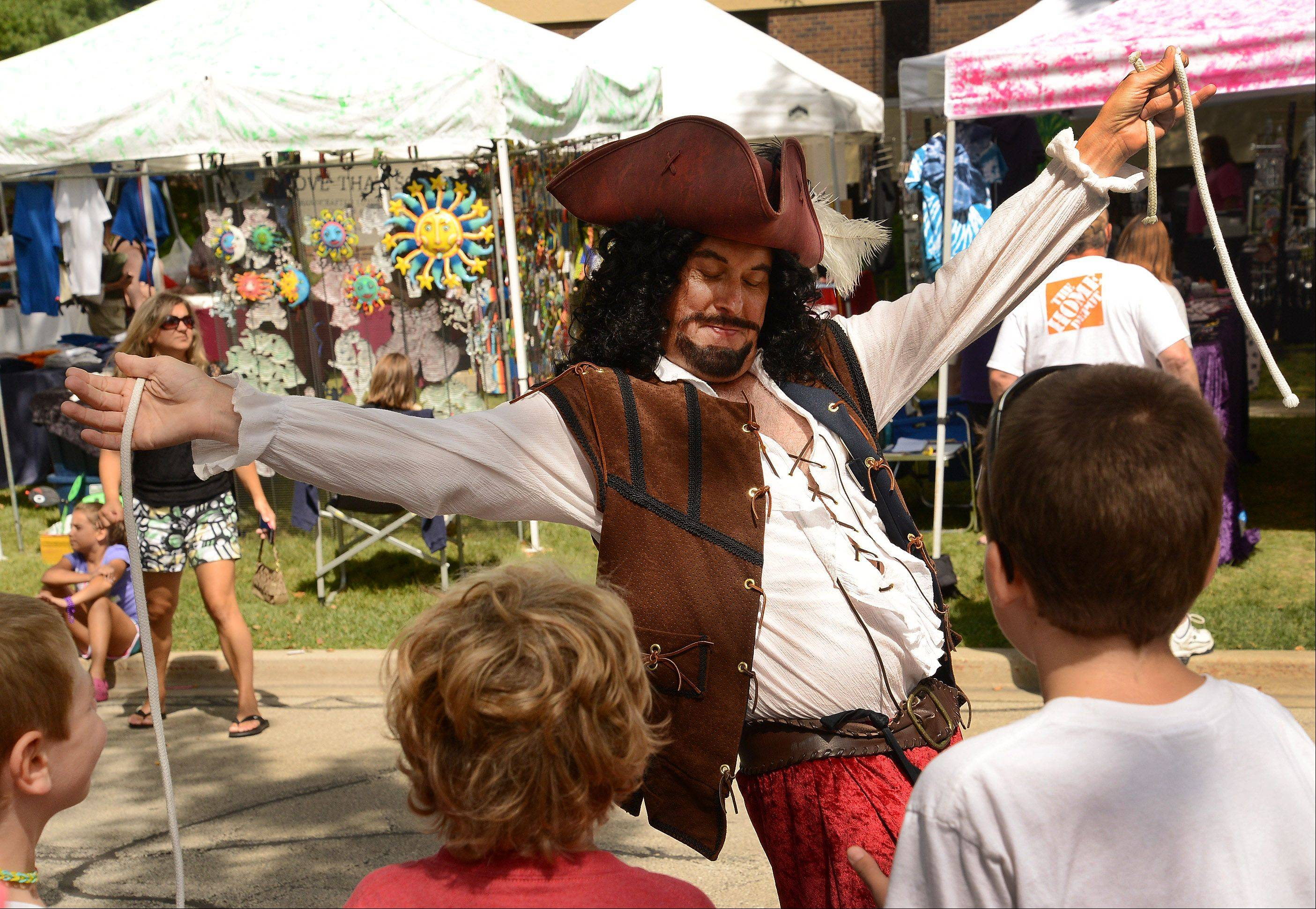 Pete the Pirate performs rope tricks during the fifth and final day of Buffalo Grove Days.