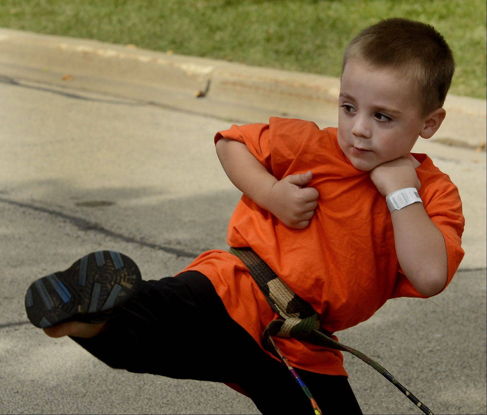 4-year-old Isaac Helkowski demonstrates some martial arts moves as he performs with Buffalo Grove Martial Arts, on the fifth and final day of Buffalo Grove Days.