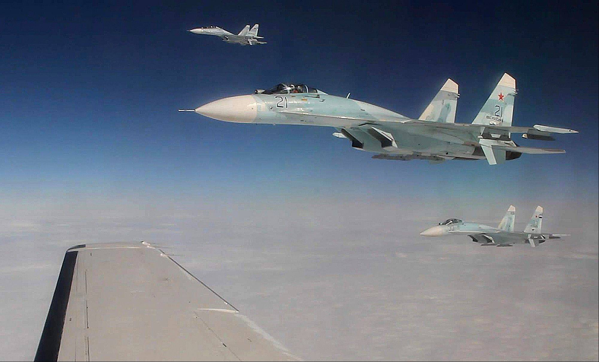 Three Russian Federation Air Force SU-27s intercept a passenger plane that was hijacked during a simulation to test the response of NORAD and Russian Federation forces. The exercise among Canadian and U.S. forces from NORAD, along with the Russian Federation, saw the Canadians successfully hand off the hijacked plane to Russian fighters over the Bering Strait.