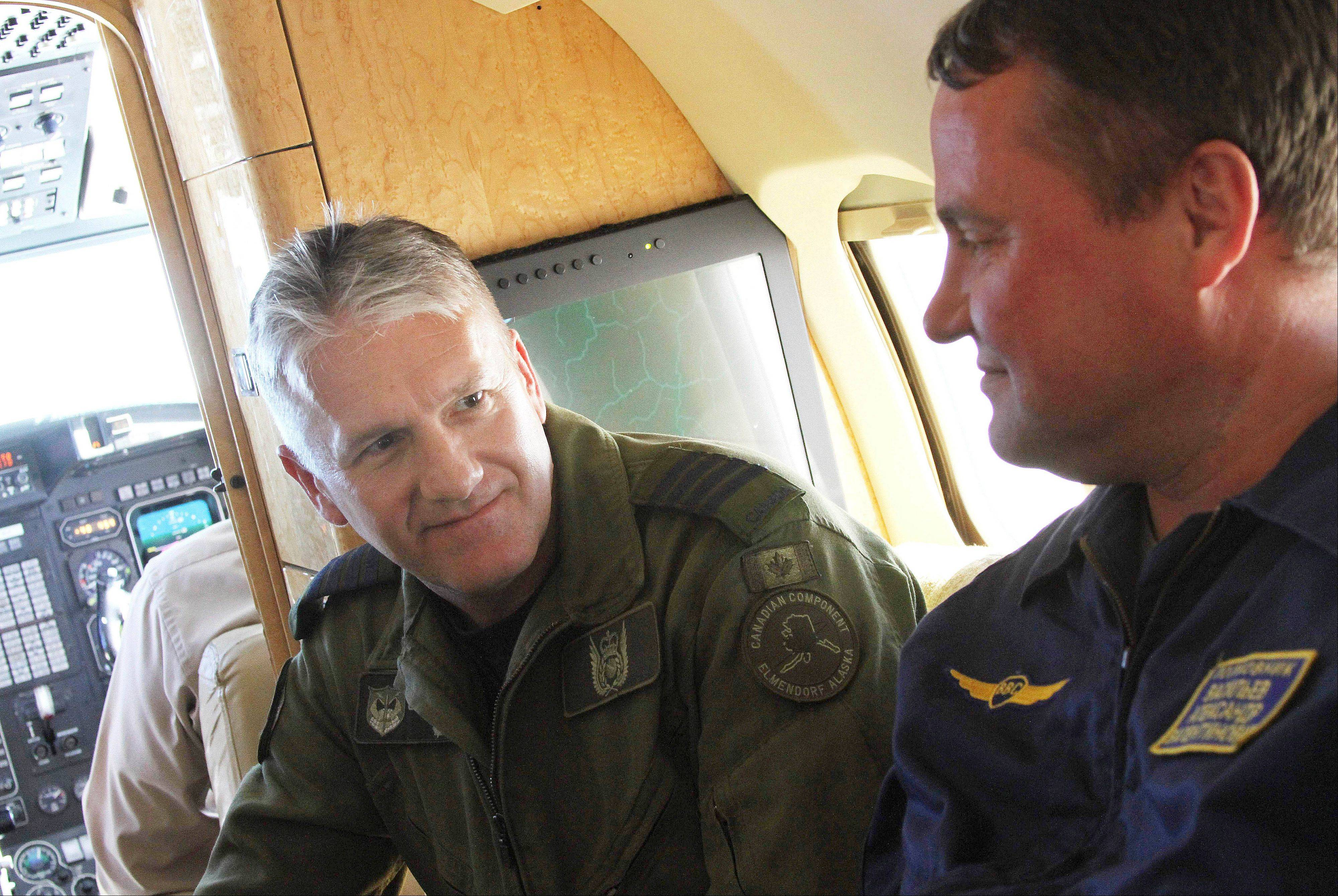 Col. Patrick Carpentier, left, deputy commander of the NORAD Alaska Region, speaks with Russian Federation Air Force Col. Alexander Vasiliev on a plane that was hijacked during a simulation to test the response of NORAD and Russian Federation forces near Alaska. The exercise involved Canadian and U.S. forces from NORAD, along with the Russian Federation, and saw the Canadians successfully hand off the hijacked plane to Russian fighters over the Bering Strait.