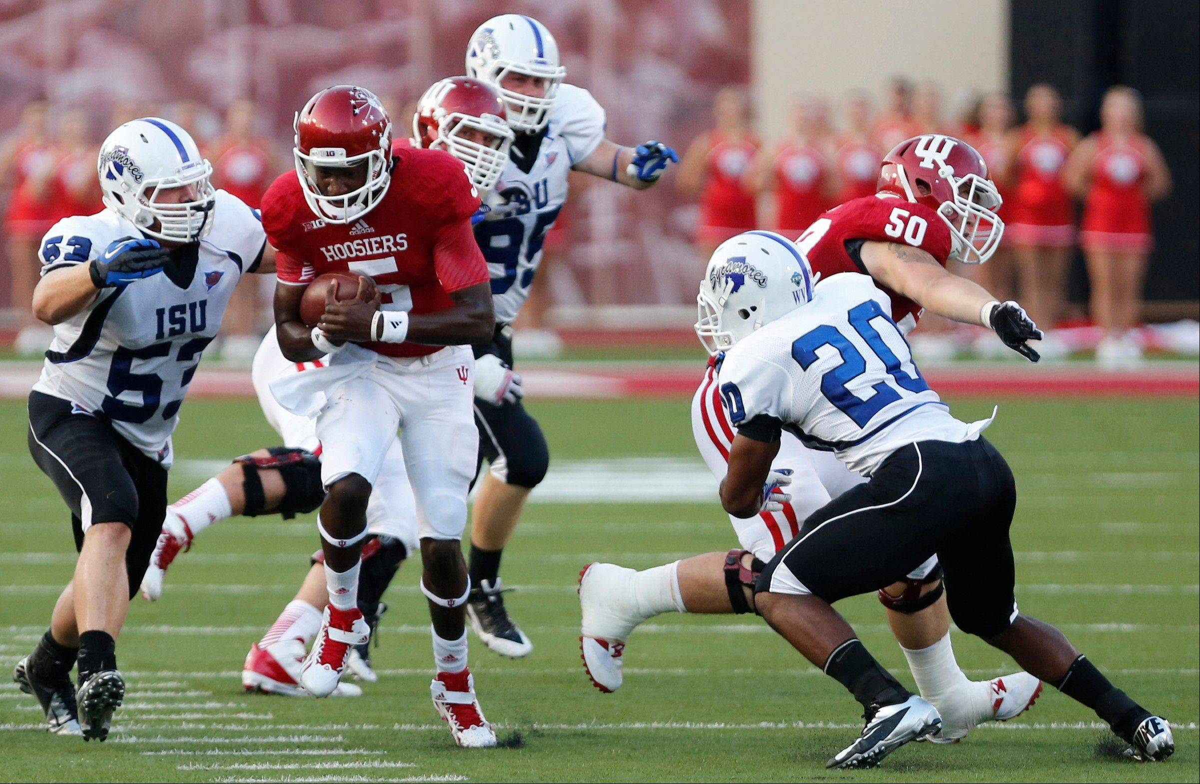 Indiana quarterback Tre Roberson (5) carries the ball against Indiana State on Thursday night at Memorial Stadium in Bloomington, Ind.