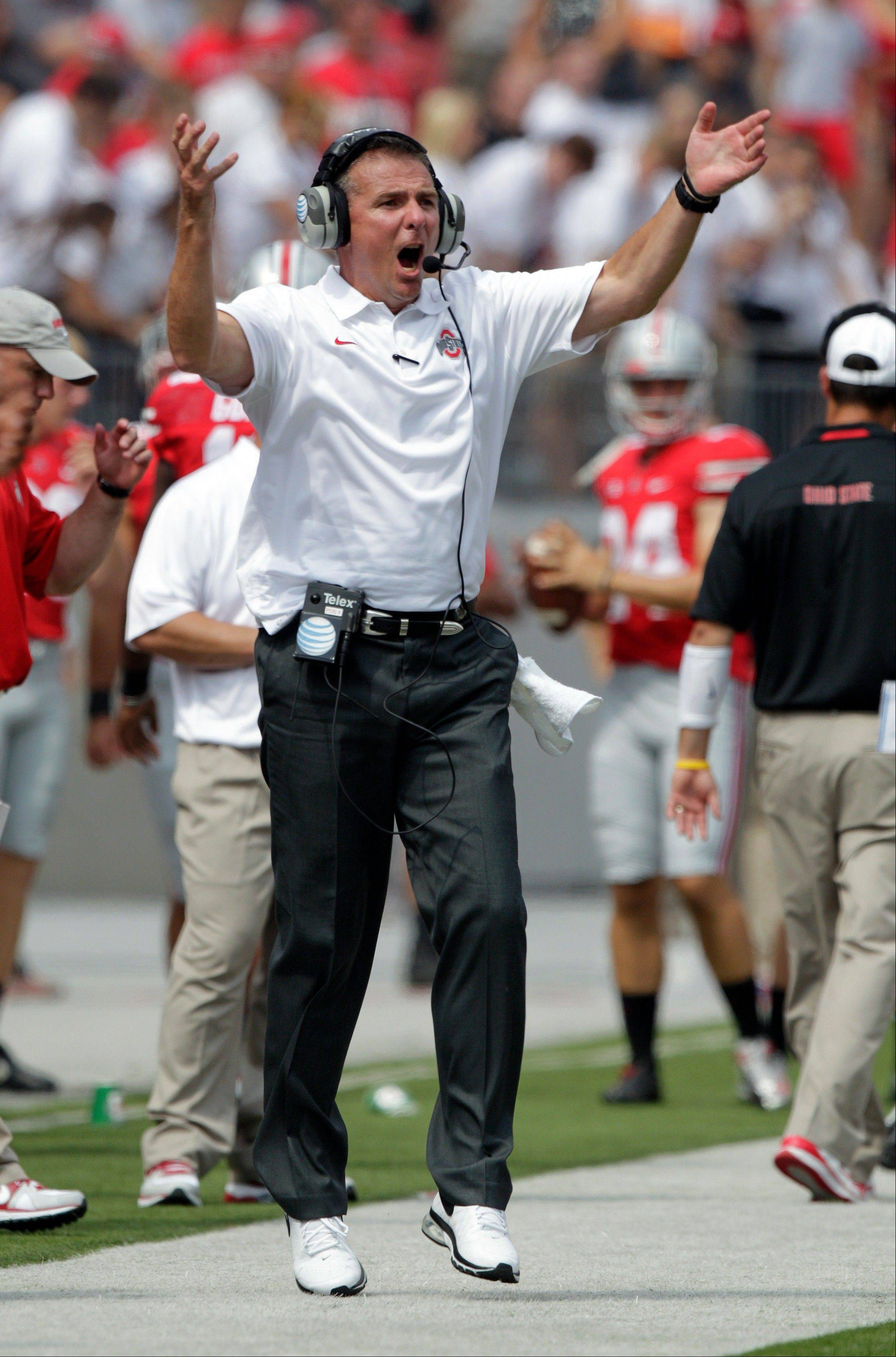Ohio State head coach Urban Meyer shouts to his team during the third quarter Saturday's game against Buffalo.