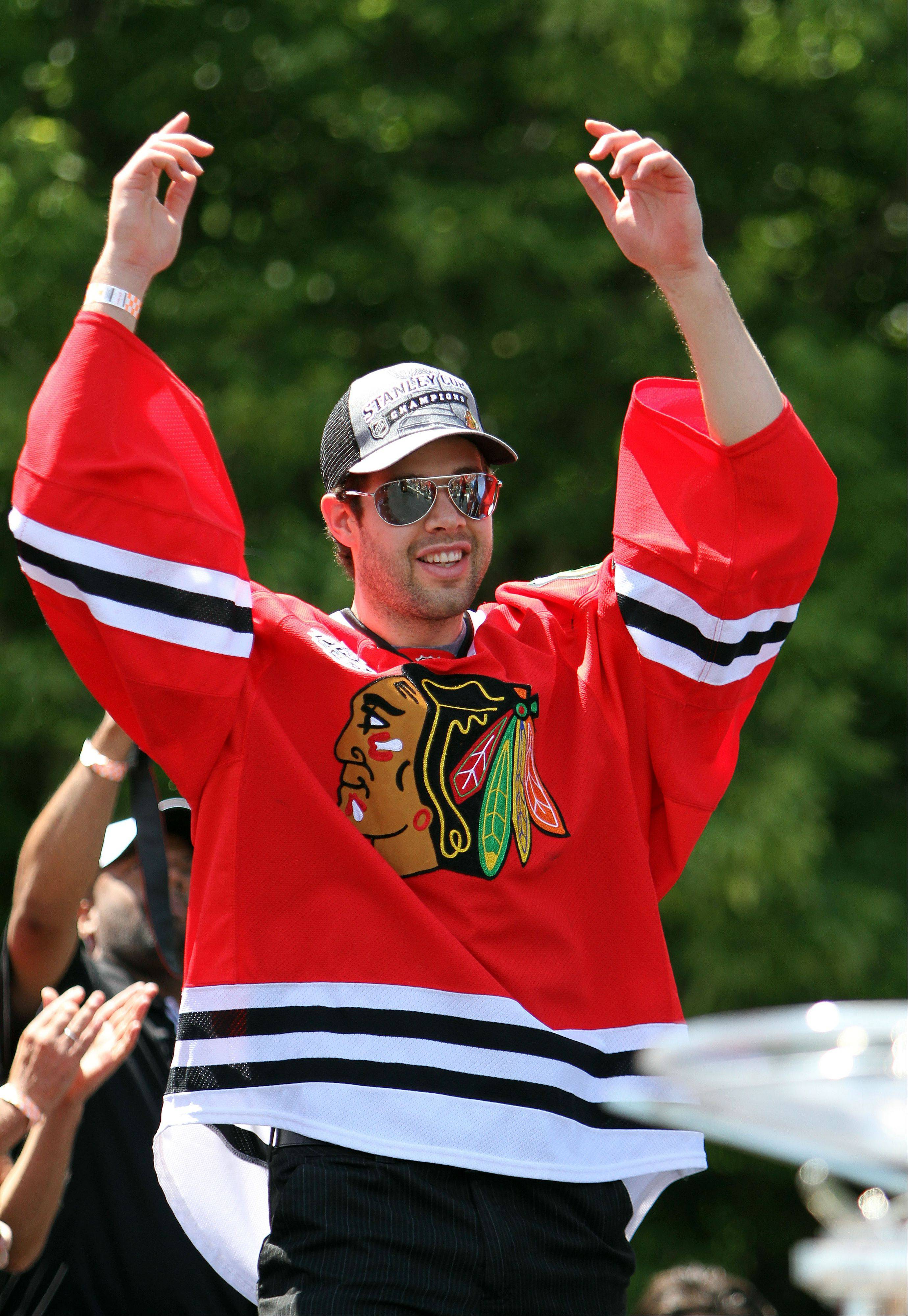 Corey Crawford was in a celebratory state during the Blackhawks' Stanley Cup rally at Hutchinson Field in Chicago last June. The 28-year-old goaltender has more reasons to celebrate: his engagement and a six-year contract extension with the Hawks.