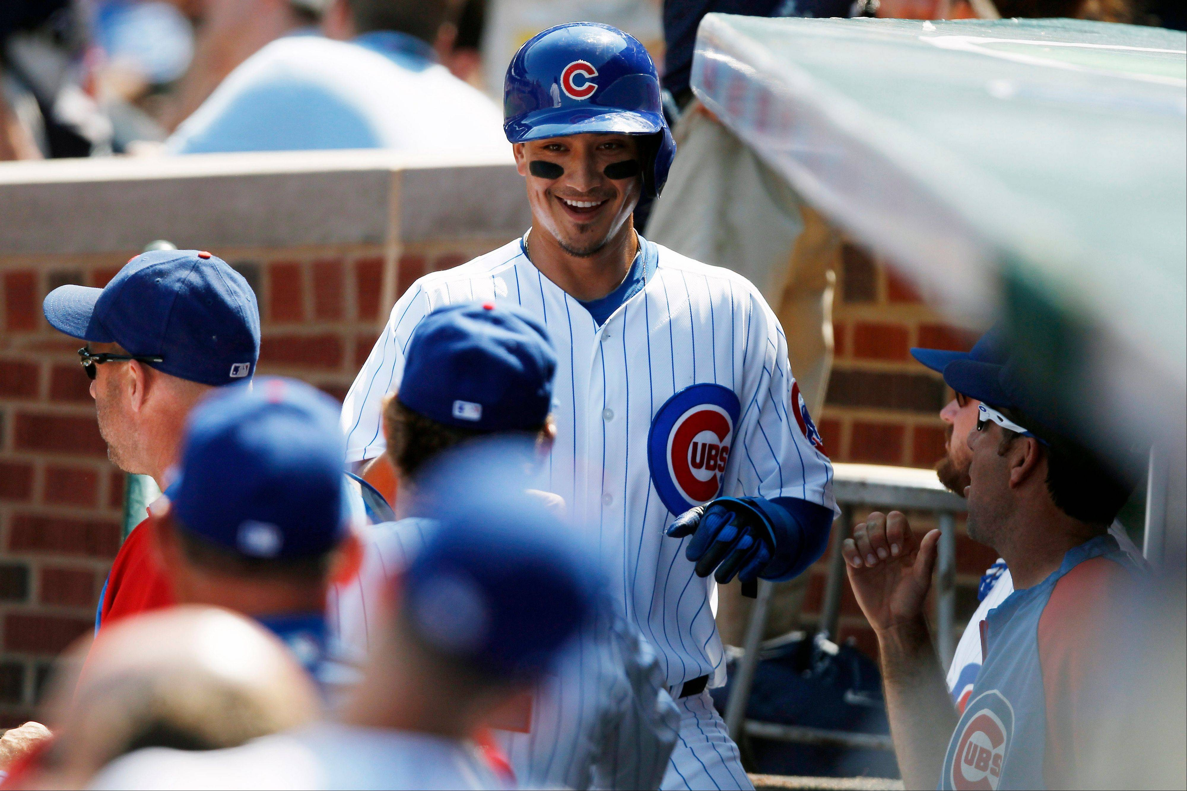 The Cubs' Darwin Barney heads to the dugout after scoring against the Phillies in the first inning Sunday.