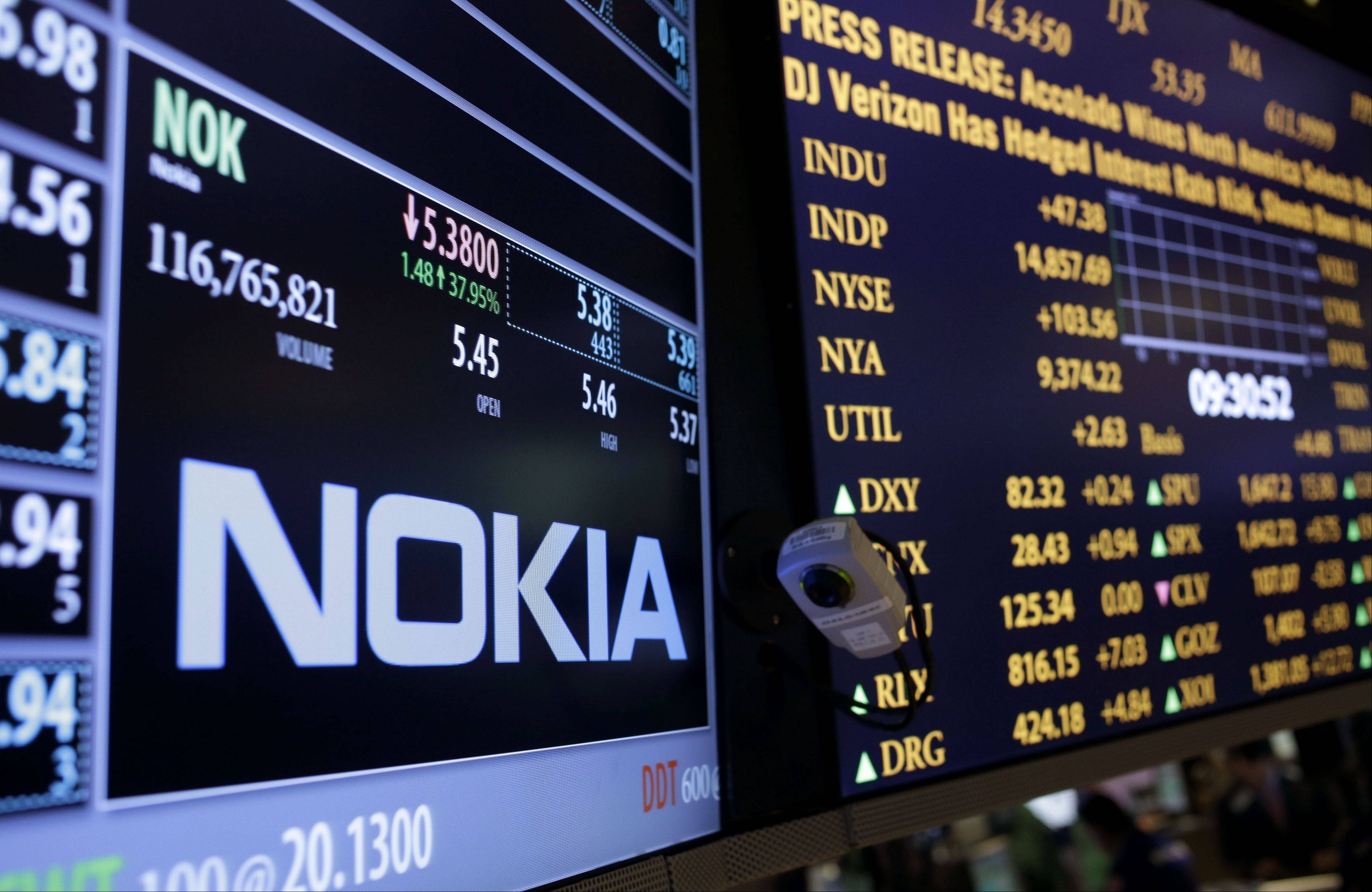 The Nokia brand name is displayed on the floor of the New York Stock Exchange in New York Tuesday after Microsoft announced it would pay $7.2 billion to acquire Nokia's line-up of smartphones and a portfolio of patents and services.