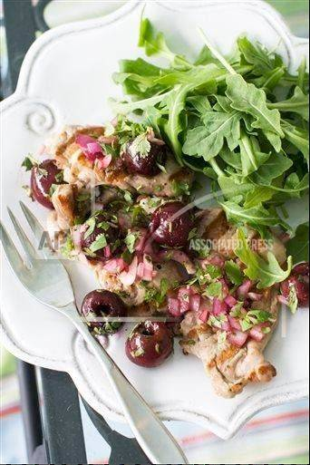 Pork tenderloin cuts lets with grilled cherry salasa perks up late summer dinners.