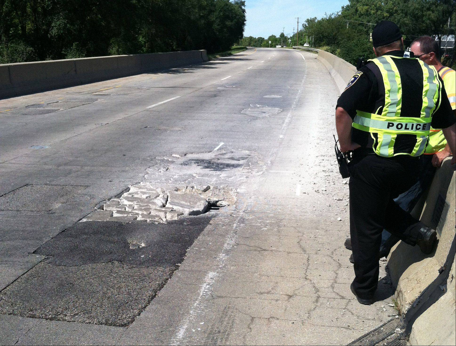 Northbound lanes of Route 12 at the Route 59 intersection is closed in Fox Lake due to a large hole in the road.