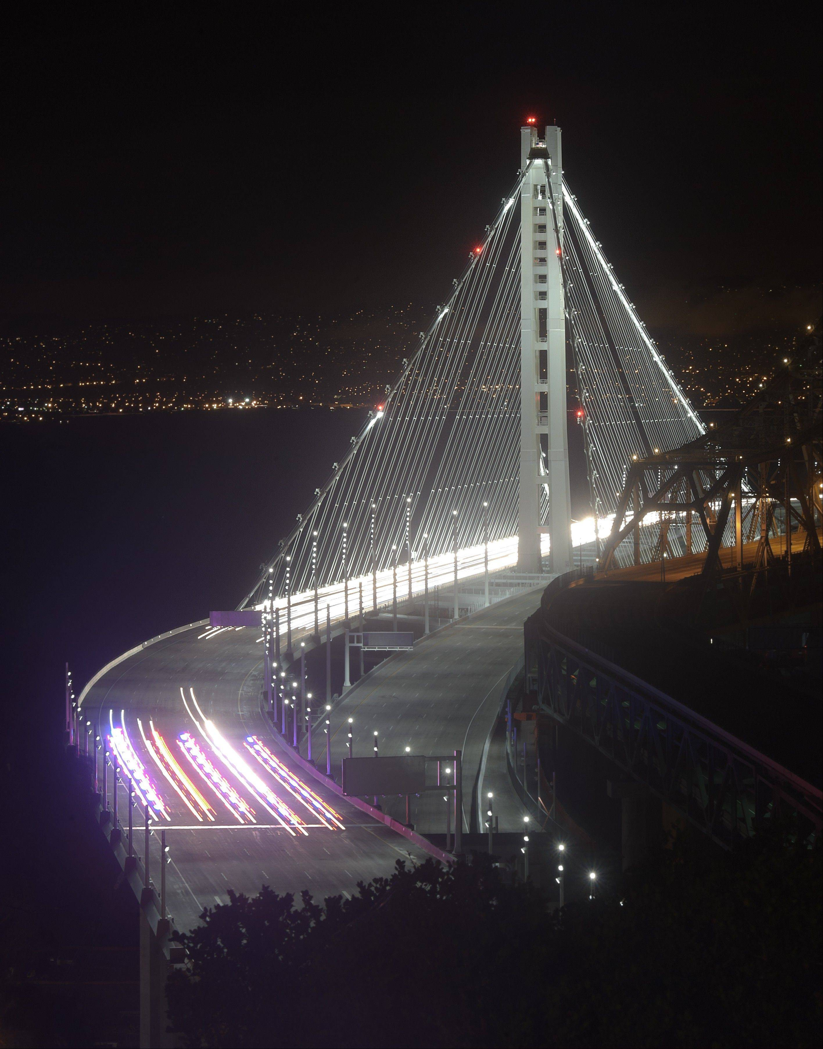 Police vehicles open the San Francisco-Oakland Bay Bridge to traffic, in San Francisco.