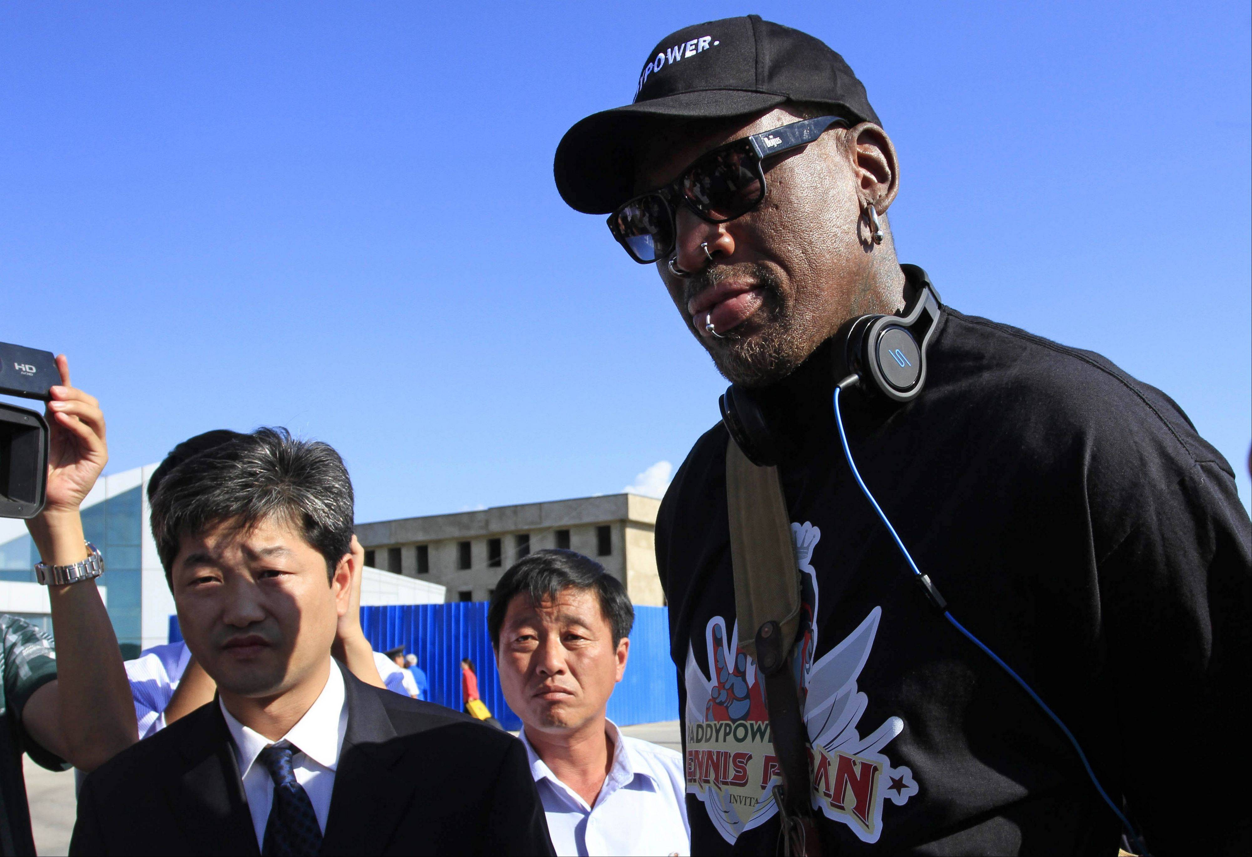 Former NBA star Dennis Rodman arrives at Pyongyang airport, North Korea, Tuesday. The former Chicago Bulls star said he plans to hang out with authoritarian leader Kim Jong Un -- but not be a diplomat.