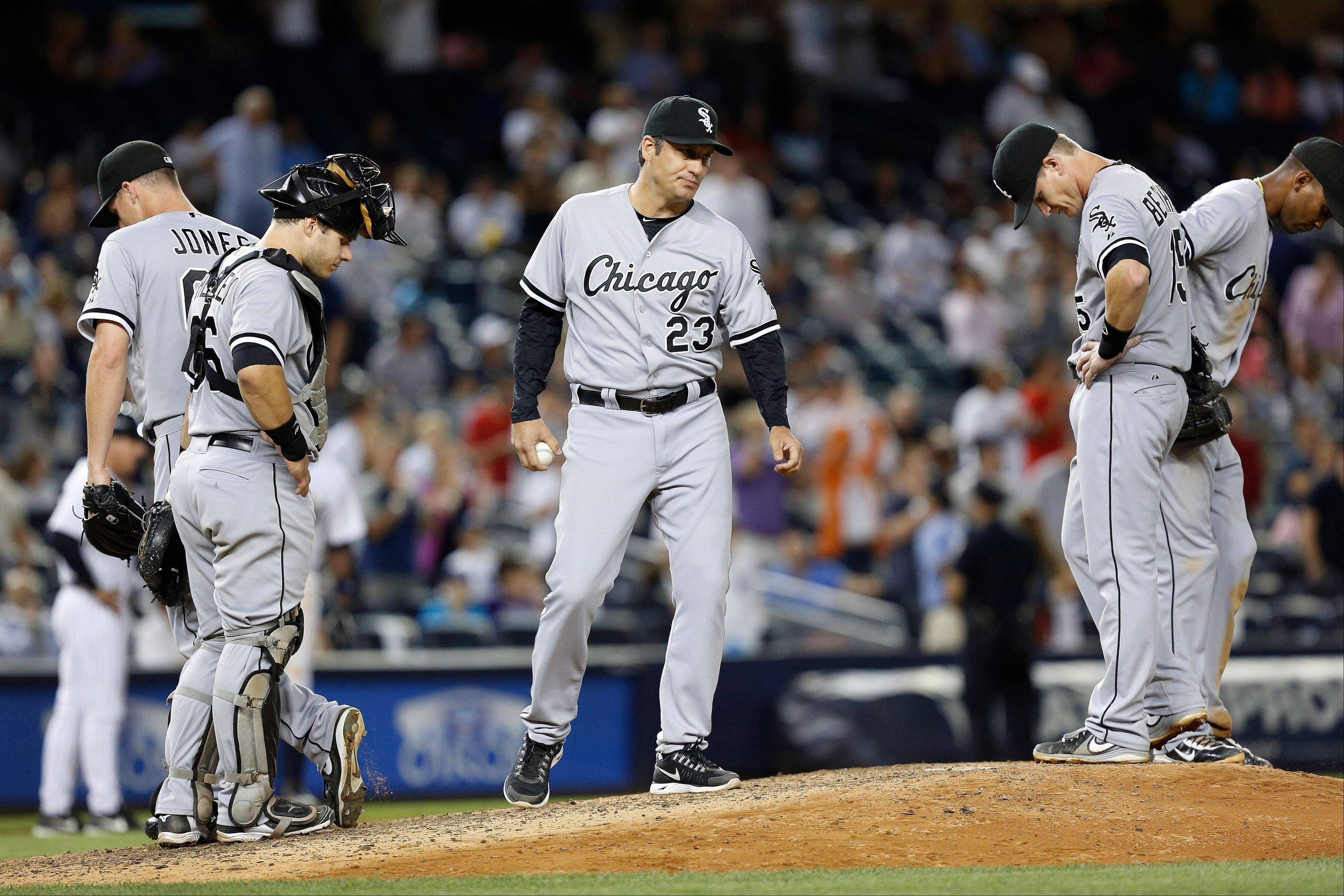 Chicago White Sox manager Robin Ventura (23) stands on the mound after removing relief pitcher Nate Jones (65) in the eighth inning of a baseball game against the New York Yankees at Yankee Stadium, Tuesday, Sept. 3, 2013, in New York.