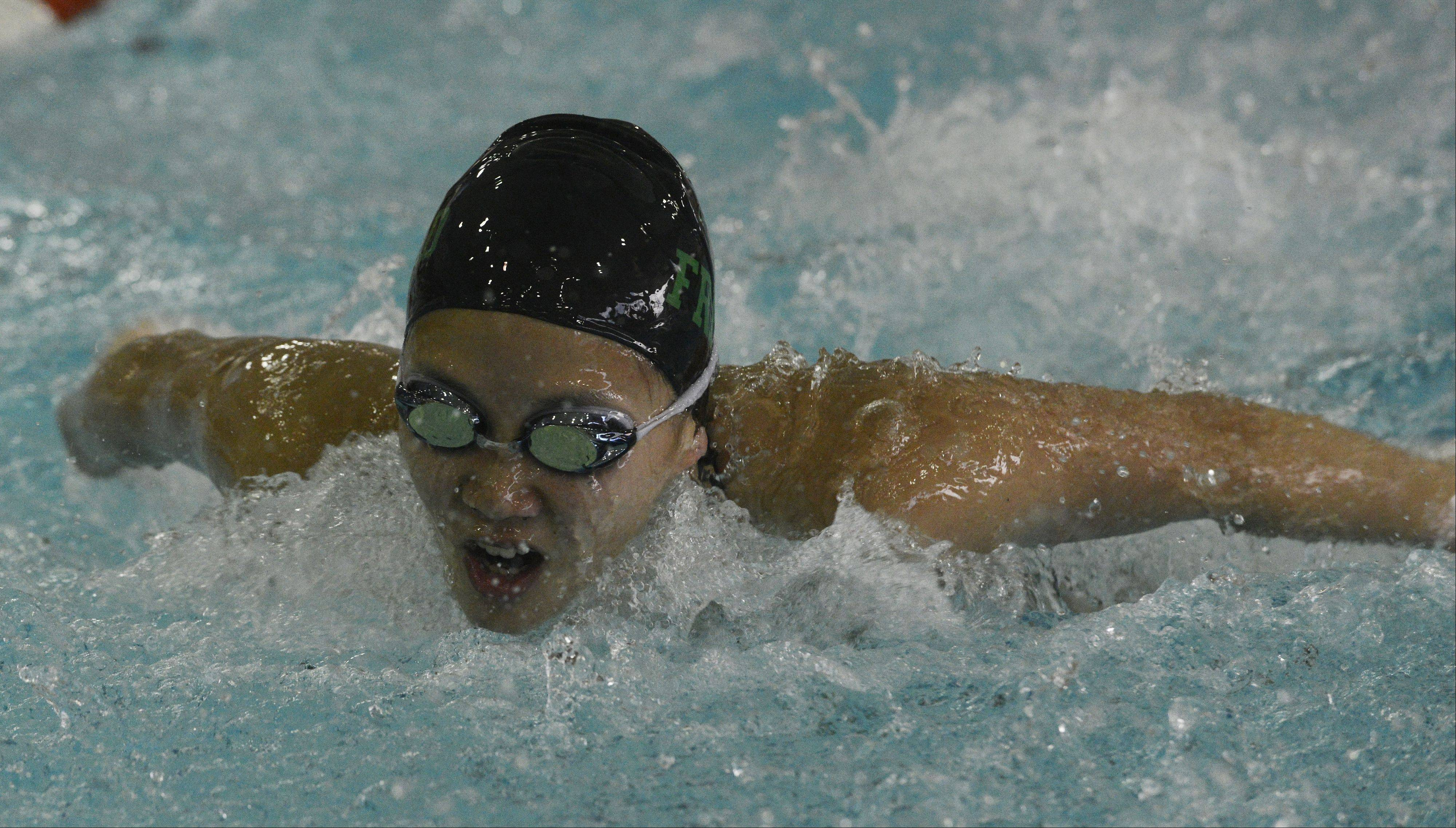 Fremd's Saki Takumiya swims butterfly in the 200-yard individual medley during Tuesday's meet against Hersey at Olympic Pool in Arlington Heights.