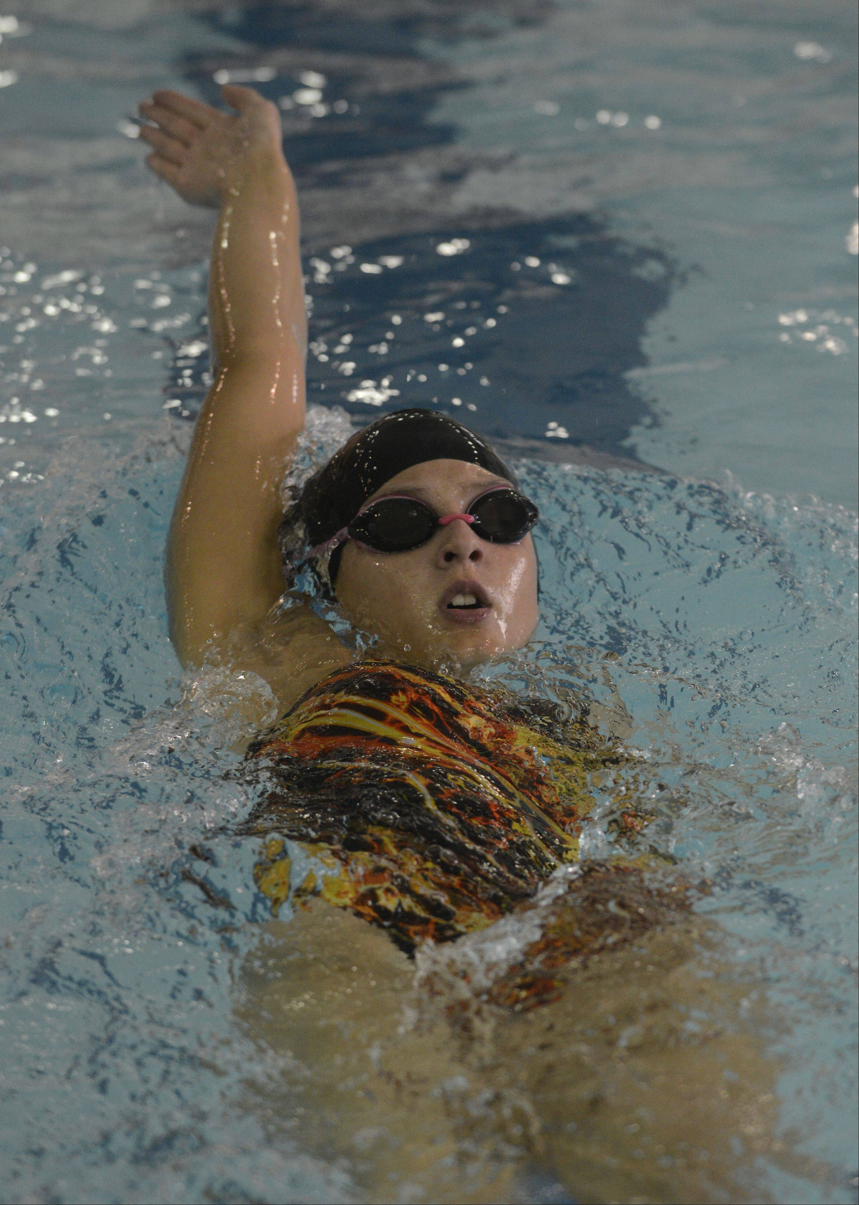 Hersey's Emma Wilcher swims backstroke during the 200-yard individual medley during Tuesday's meet against Fremd at Olympic Pool in Arlington Heights.